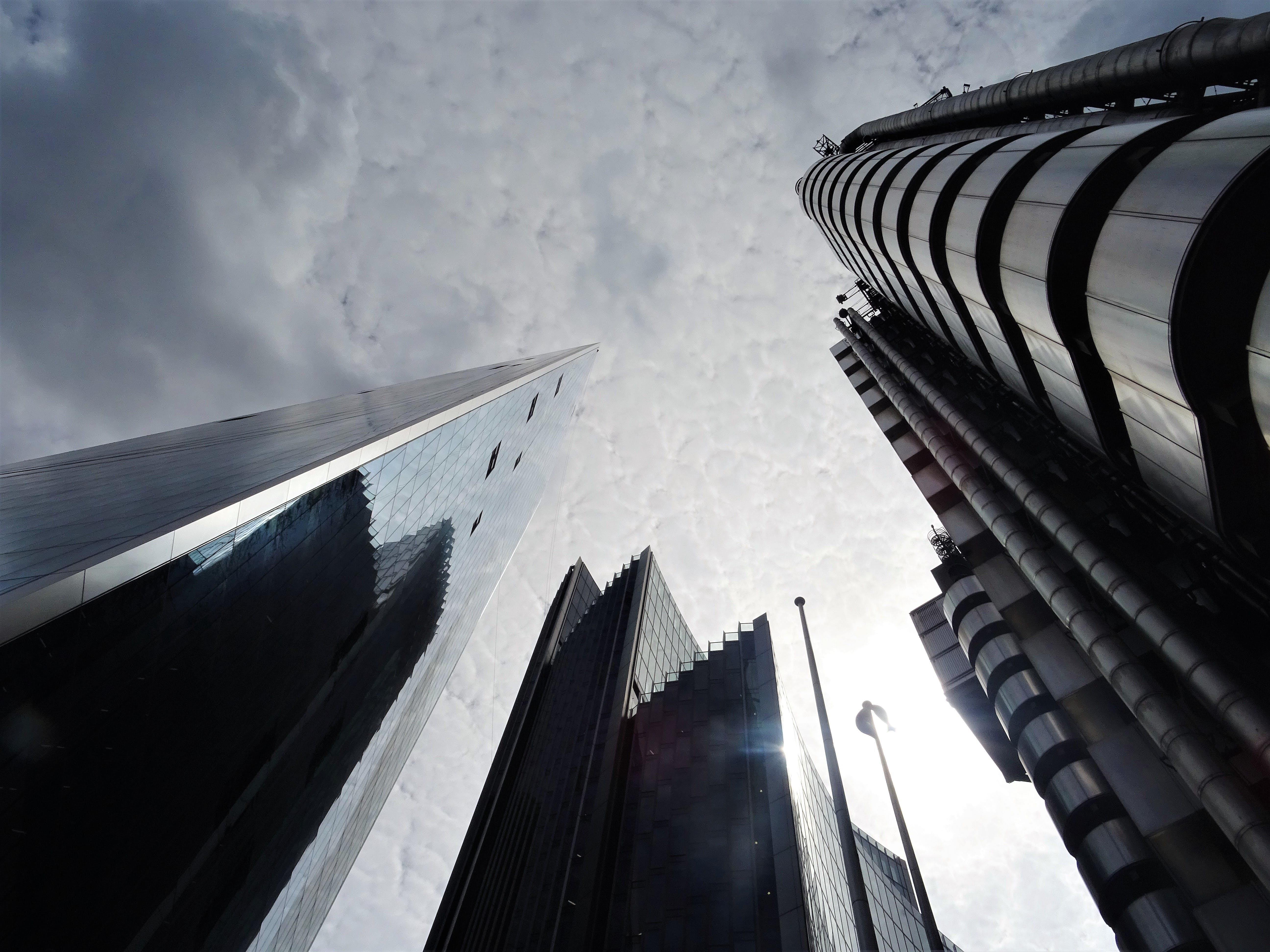 Low Angle Photo of High-rise Building over Cloudy Sky