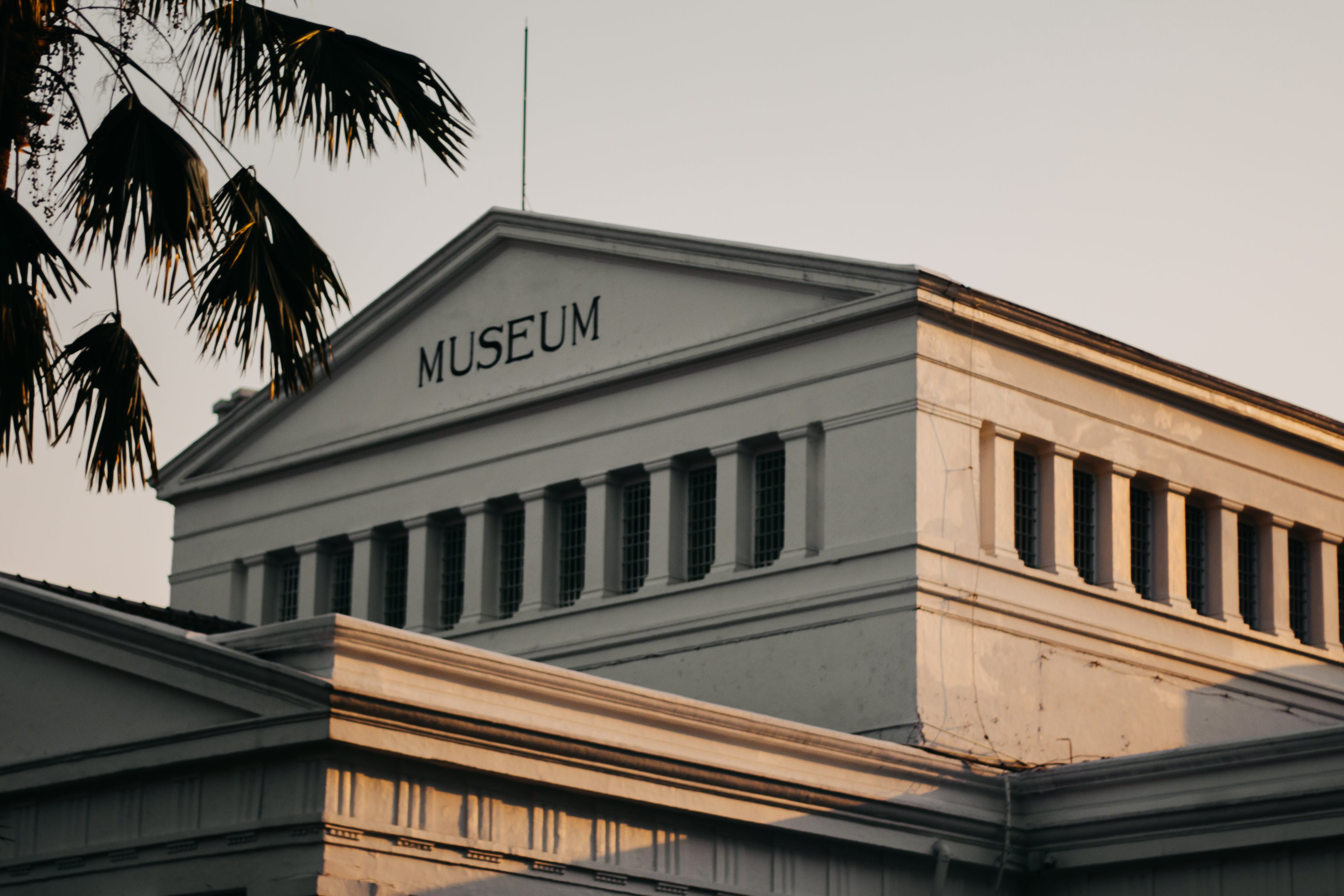 Low Angle Photo of White Museum during Golden Hour