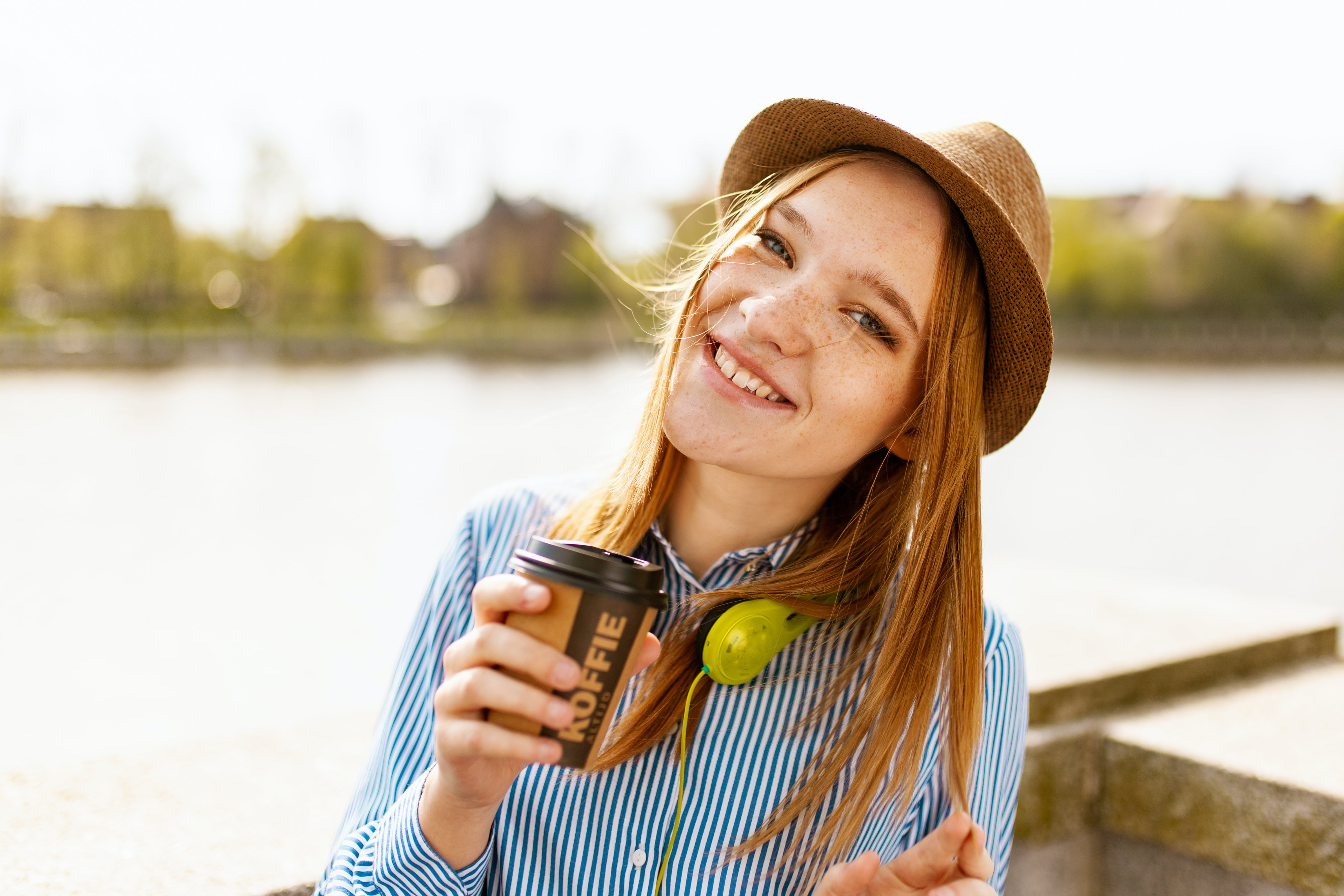 Woman Holding Cup While Taking Photo