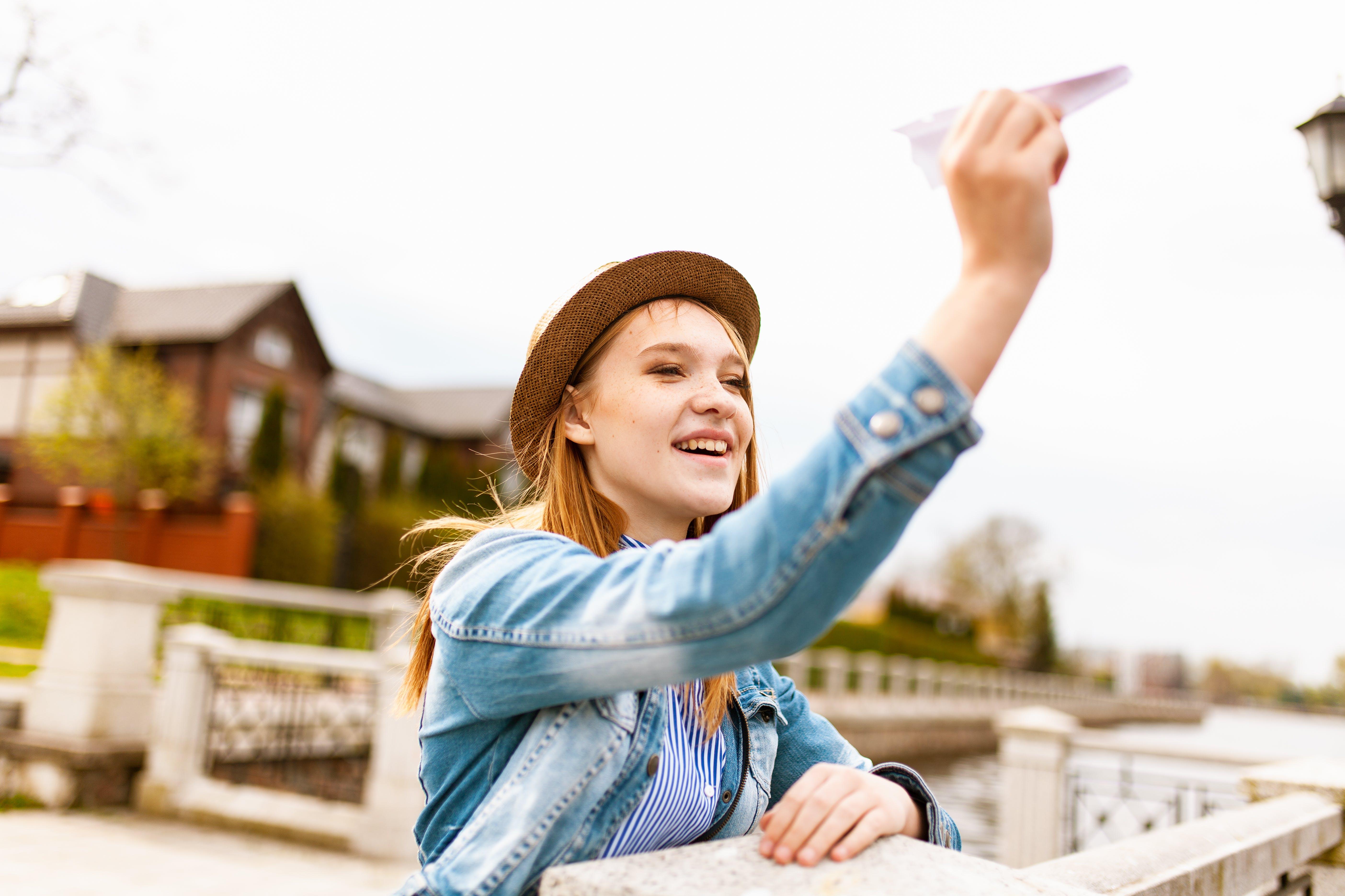 Woman Holding Paper Plane