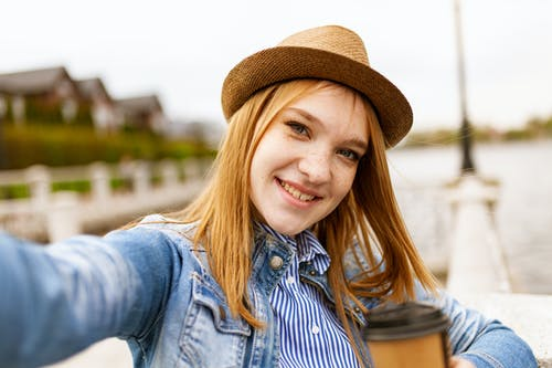 Woman Taking Selfie While Smiling