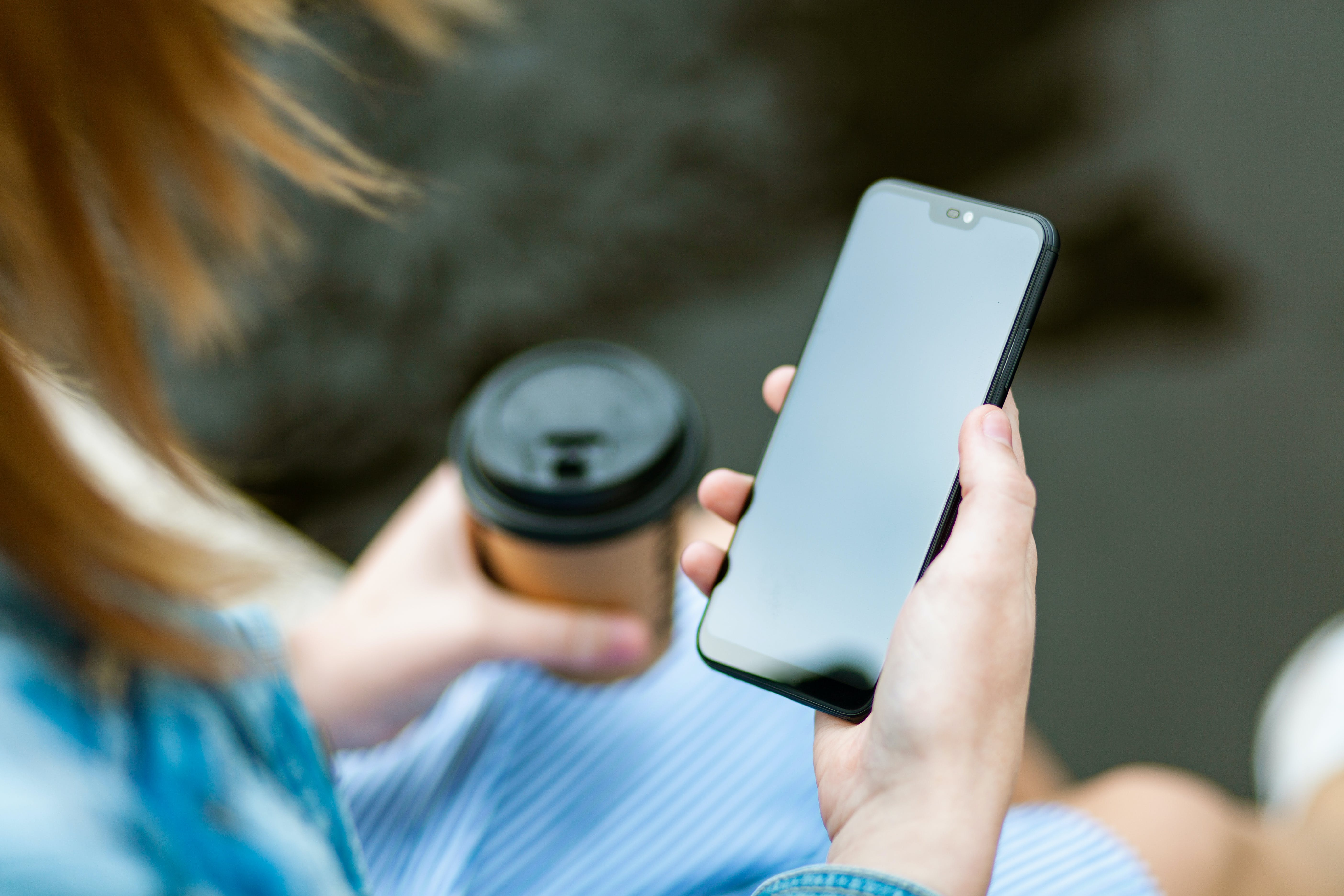 Woman Holding Black Smartphone With Black Screen