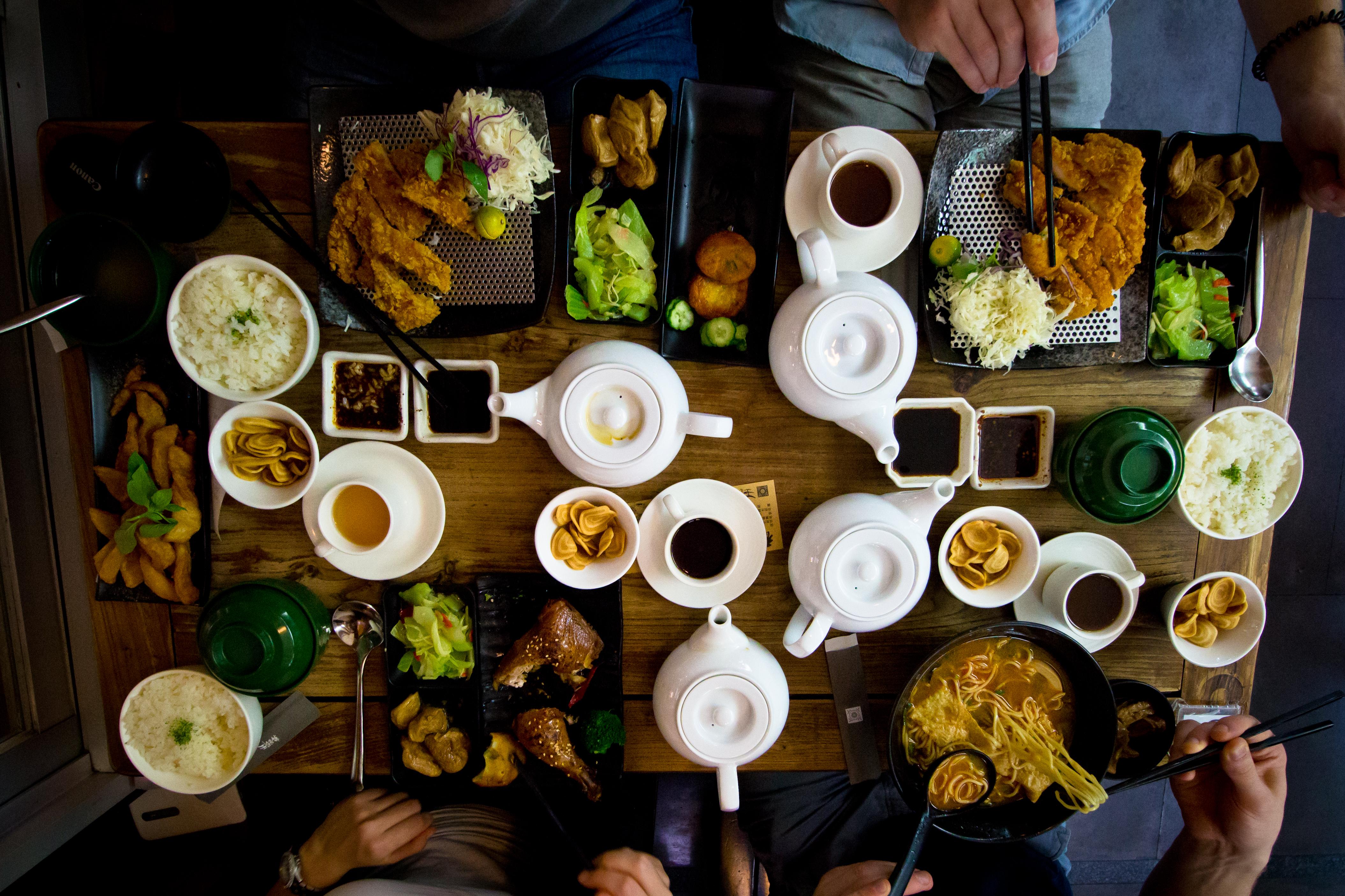 Flat Lay Photo of Katsu, Tea Set, and Bowl of Ramen