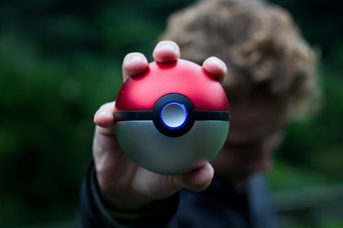 Person Holding Pokemon Ball Toy