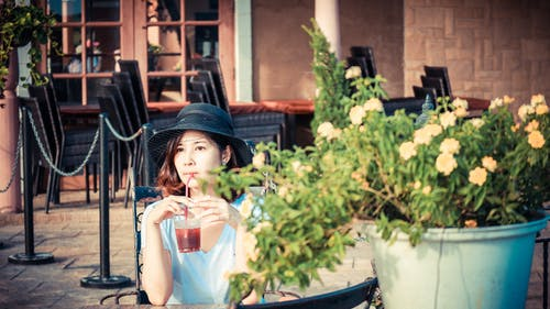 Woman Drinking Red Liquid