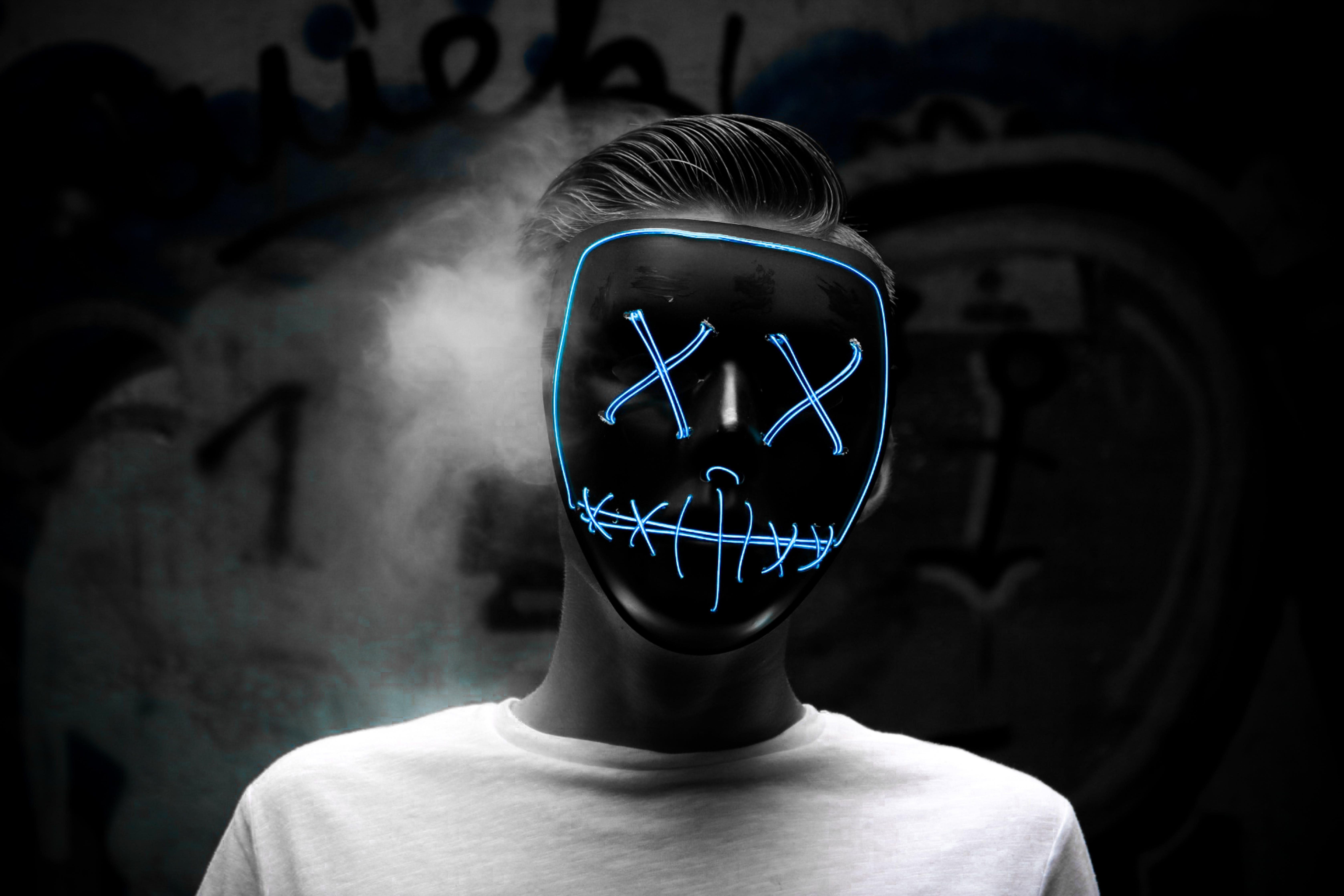 Grayscale Photo of Man Wearing Blue Mask