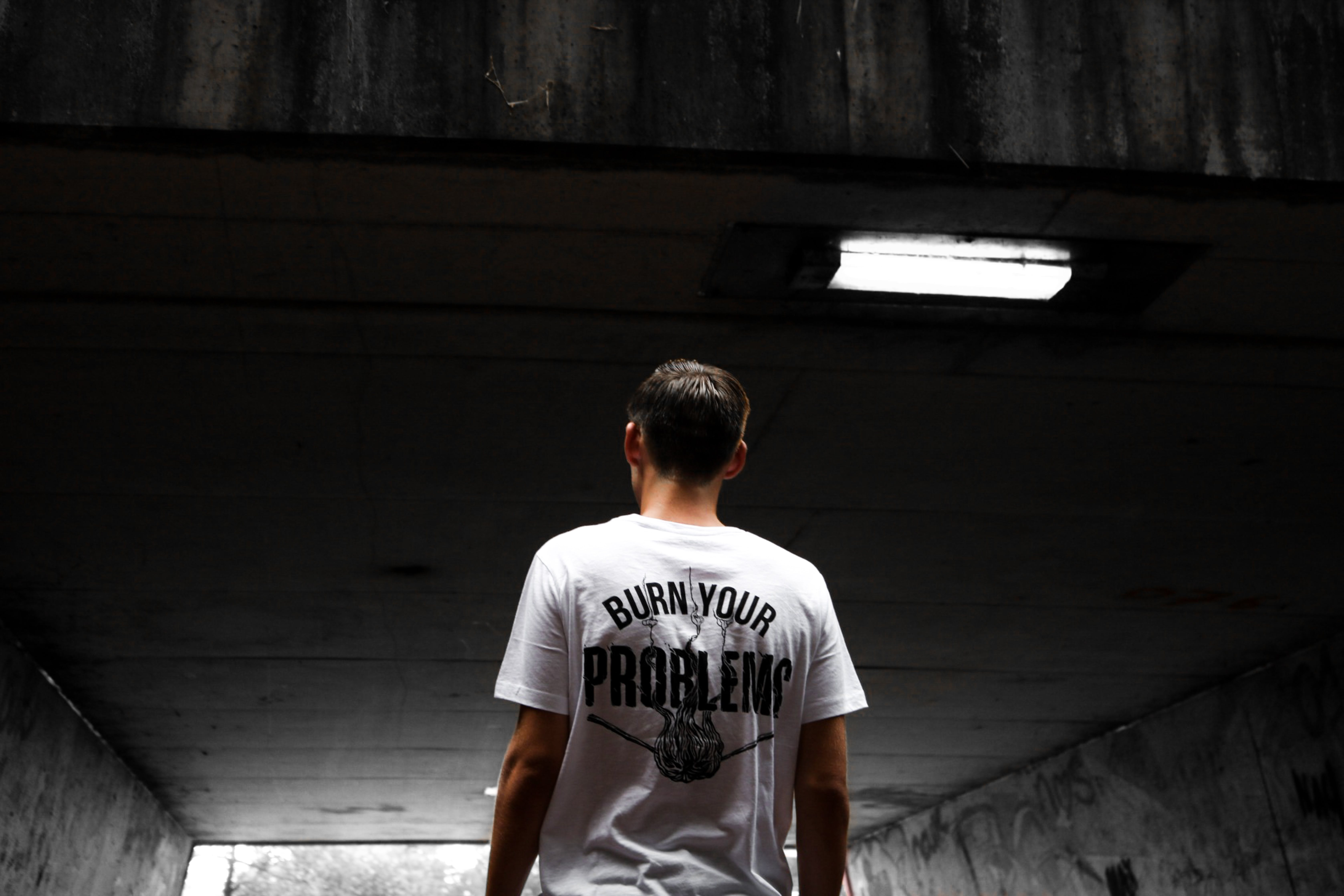Man Wearing White and Black Burn Your Problems Printed T-shirt