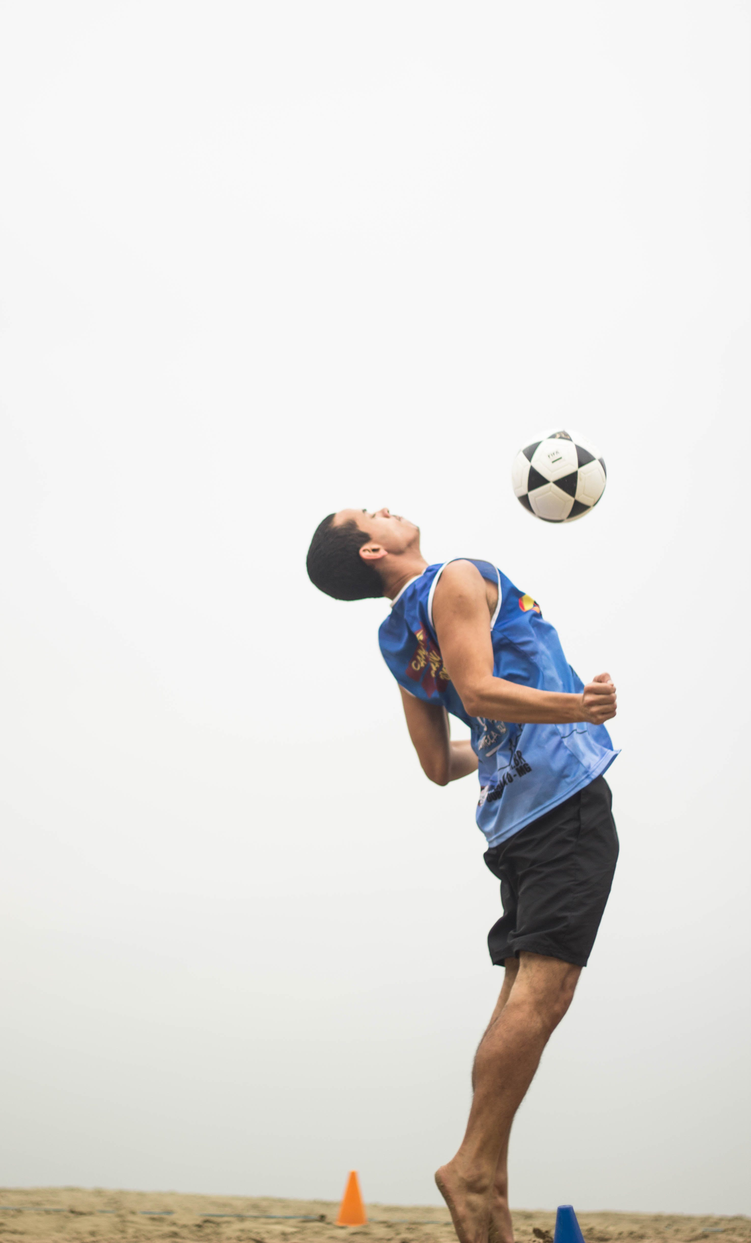 Man Playing Soccer Ball