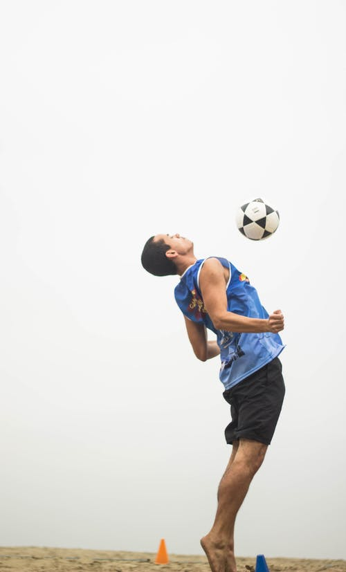 Man Playing Soccer Ball