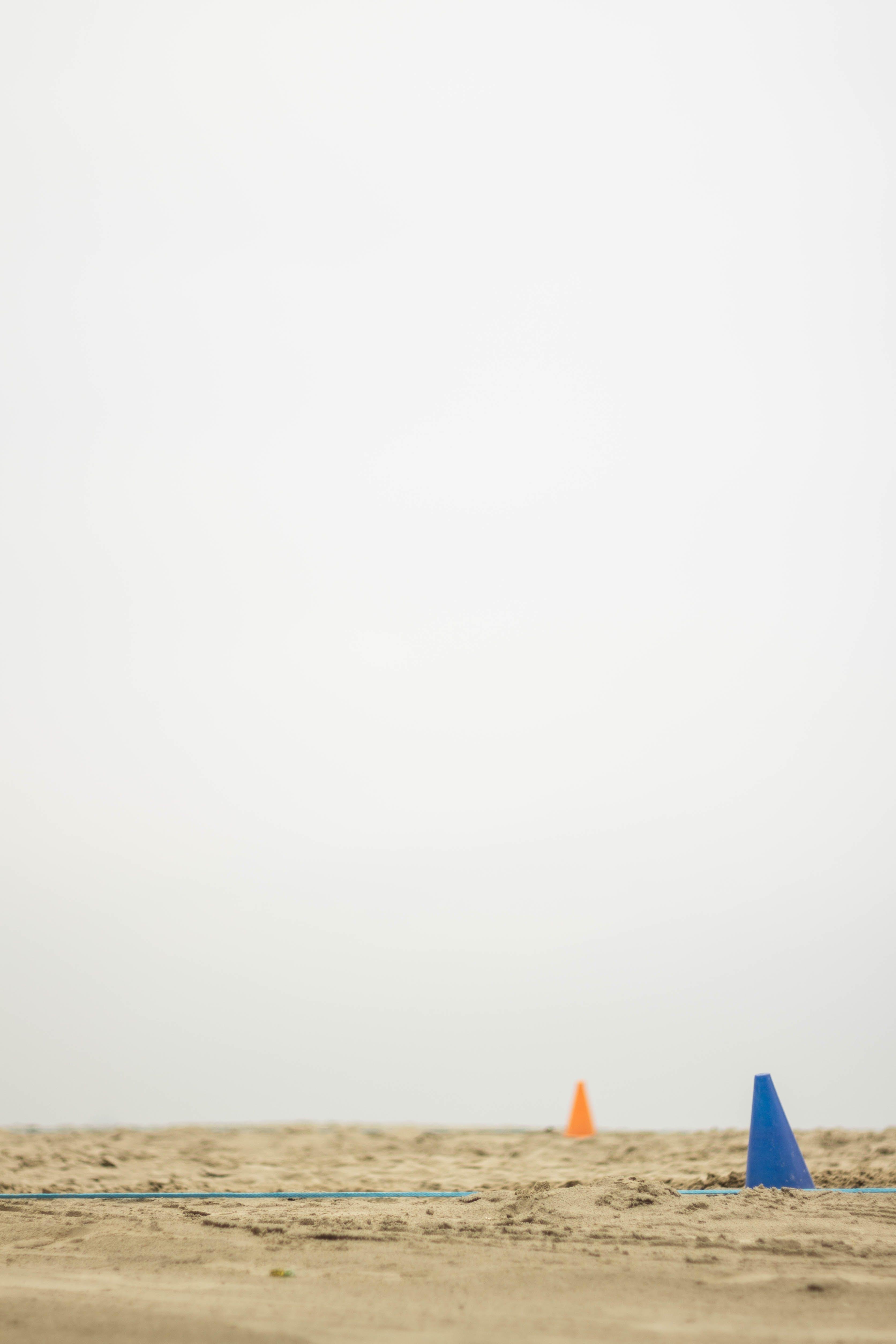 Blue and Orange Cones on Sand