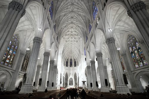 Interior of neo Gothic cathedral with colonnade and arched windows