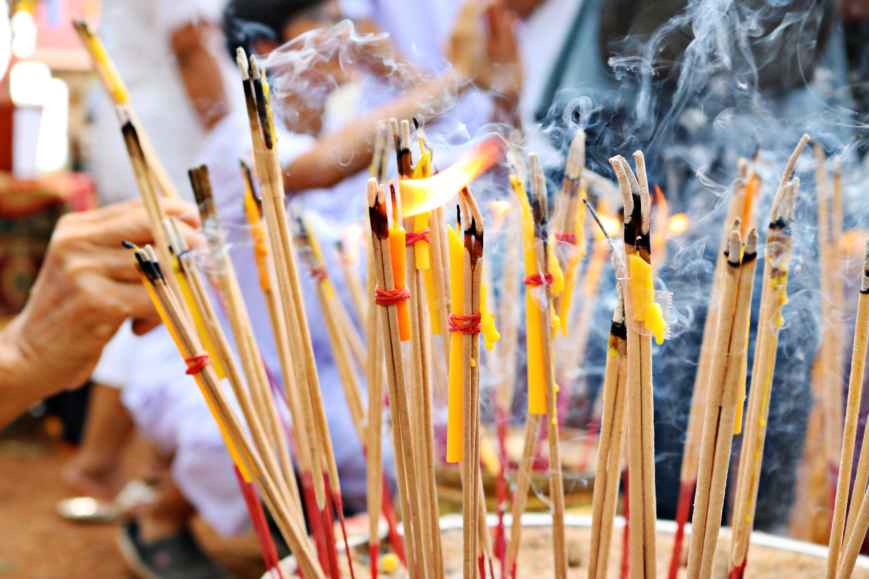 Close-up Photo of Lighted Incense Sticks