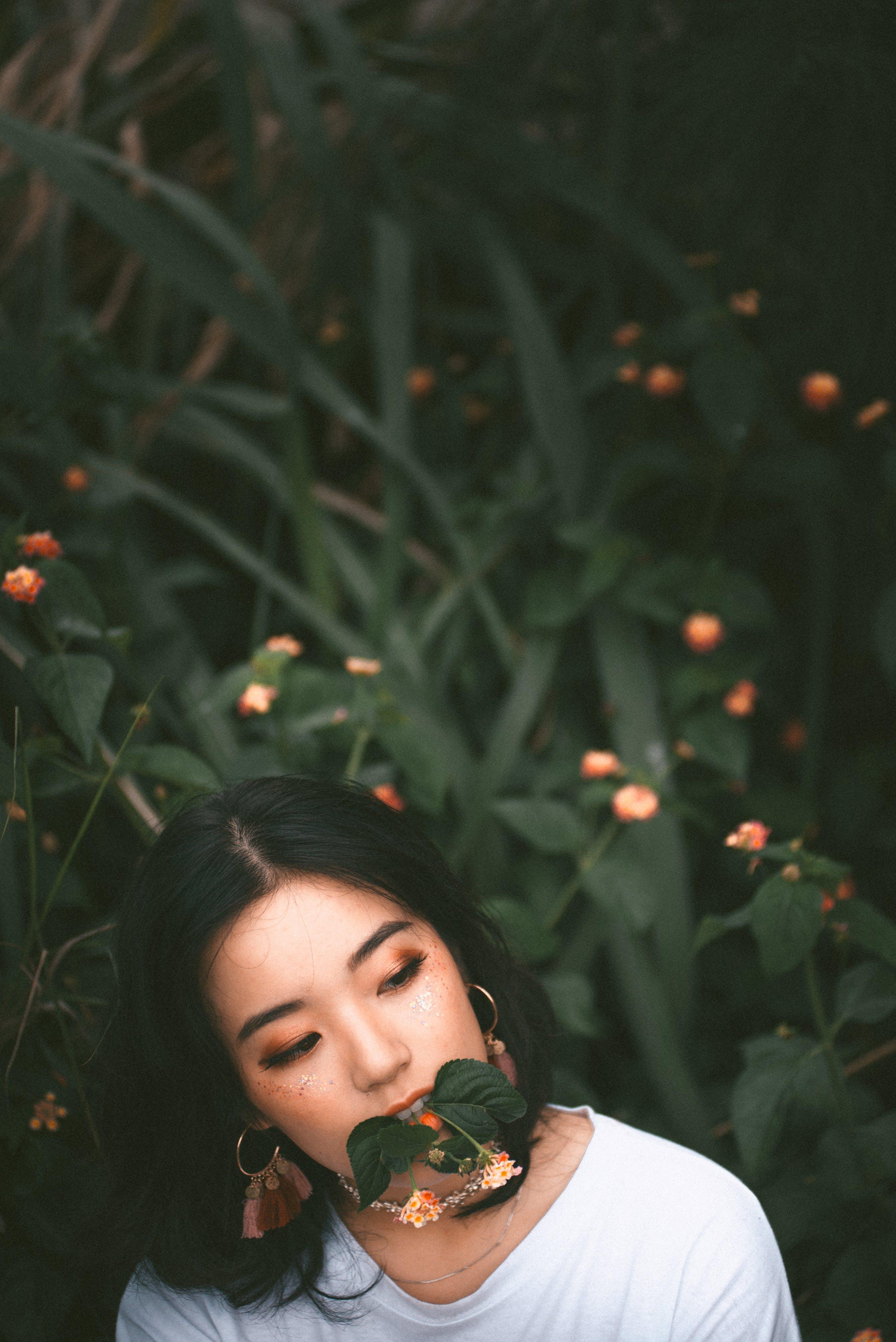 Woman Biting Green Leaf