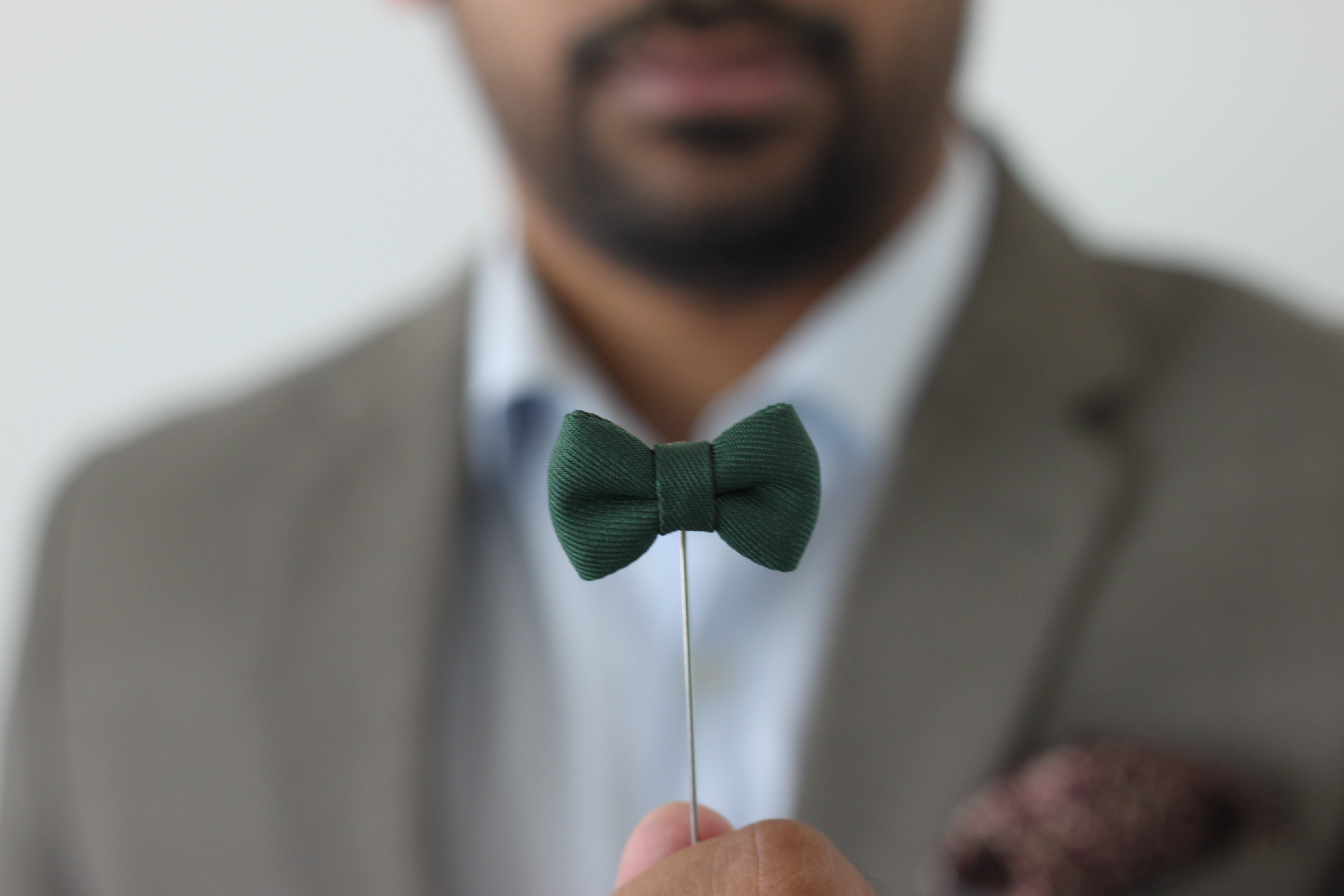 Green Bow Tie Forced Perspective Selective Focus Photo