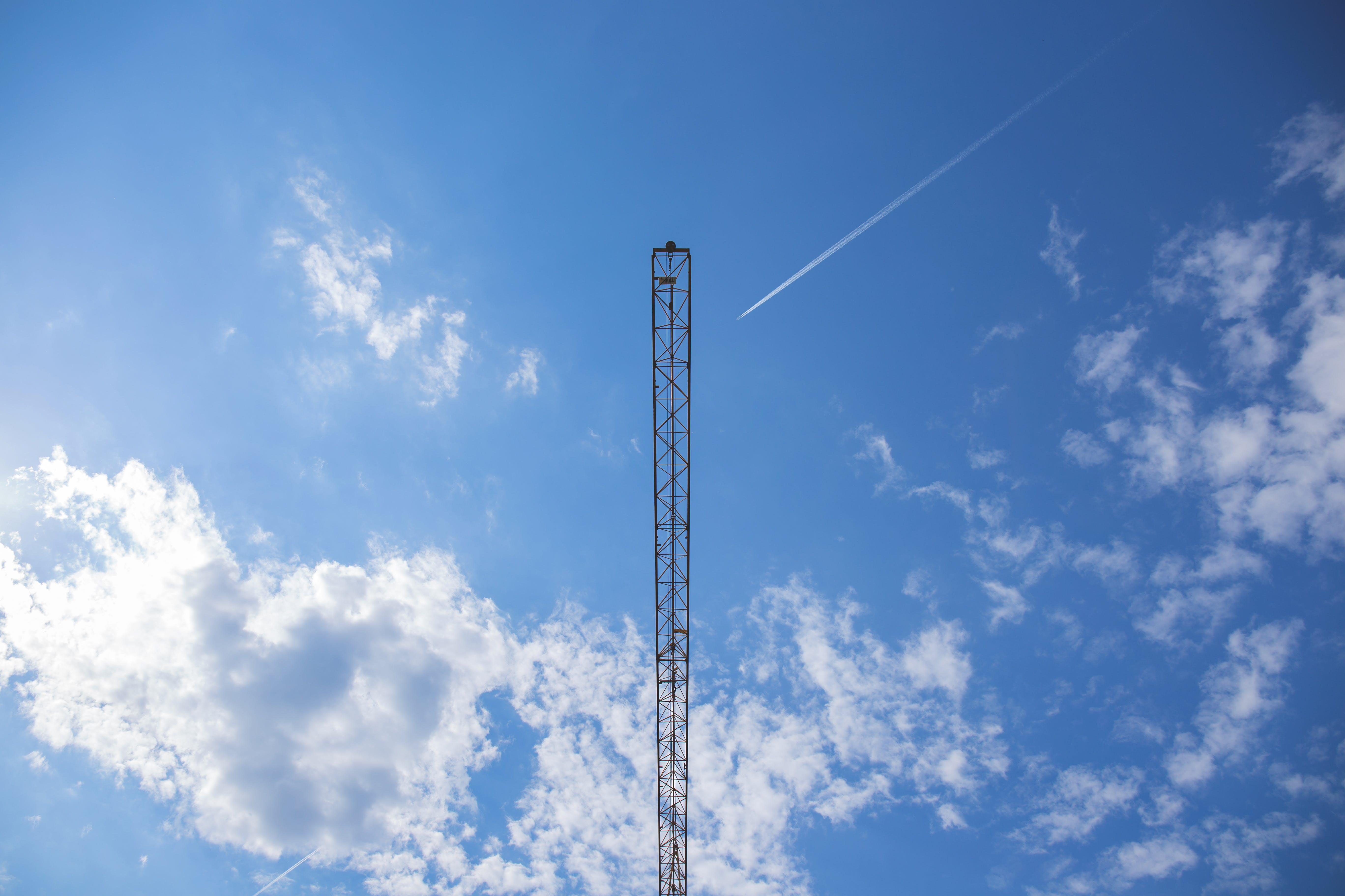 Black Tower Under Blue Sky during Daytime