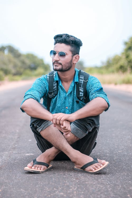 Man Sitting On Road