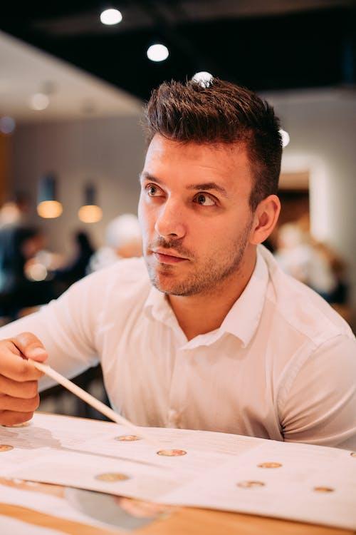 Man Holding Chopsticks