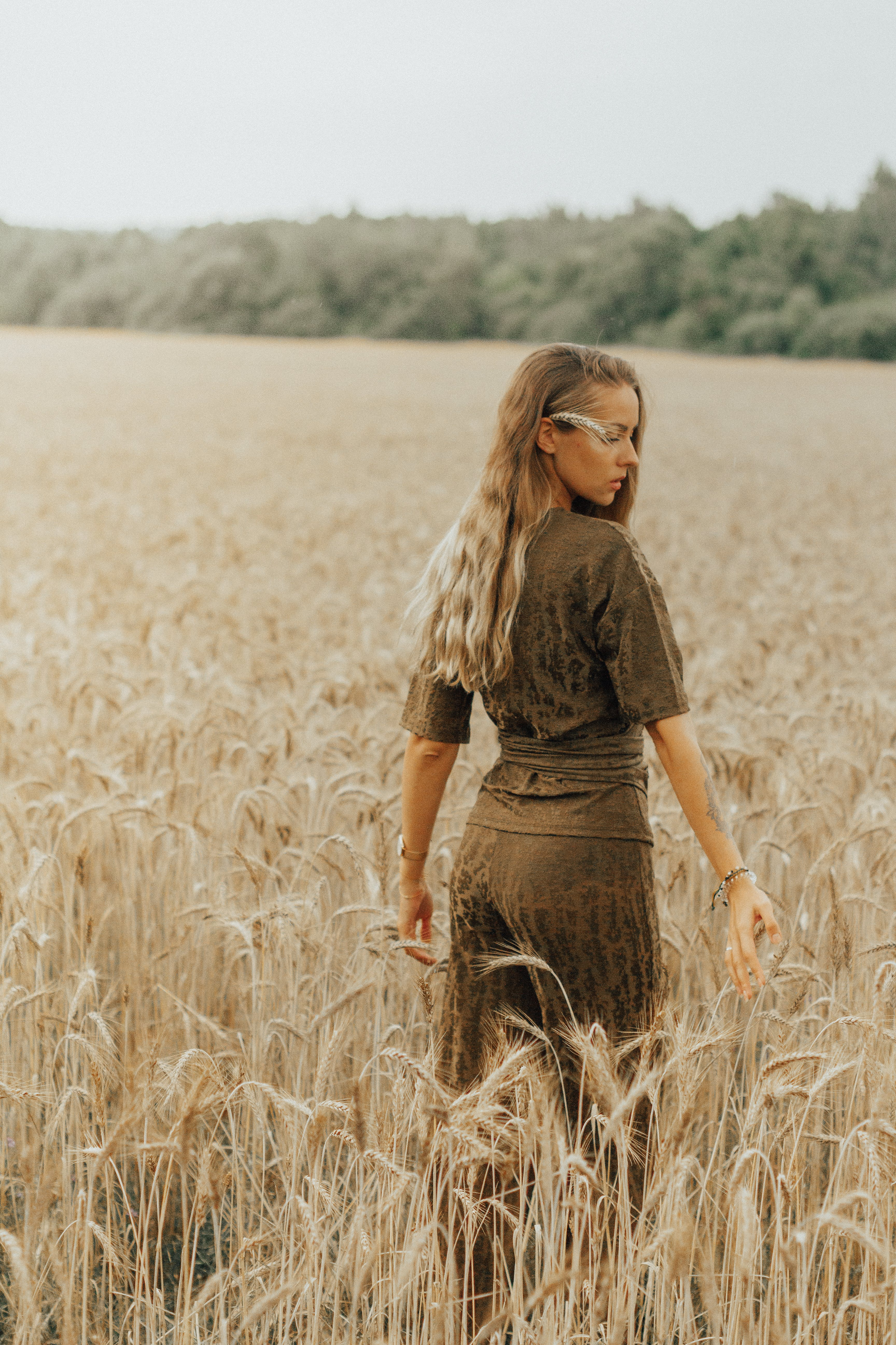 Woman Standing At Wheat Fields