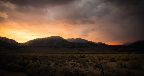 alev, dağlar, gün batımı, parıldayan içeren Ücretsiz stok fotoğraf