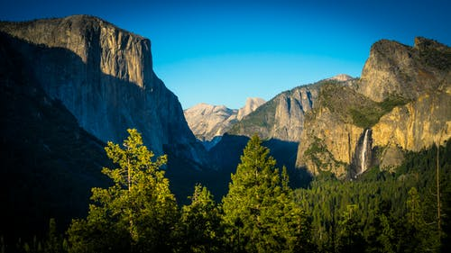 Free stock photo of cliffs, forrest, green, tunnel view