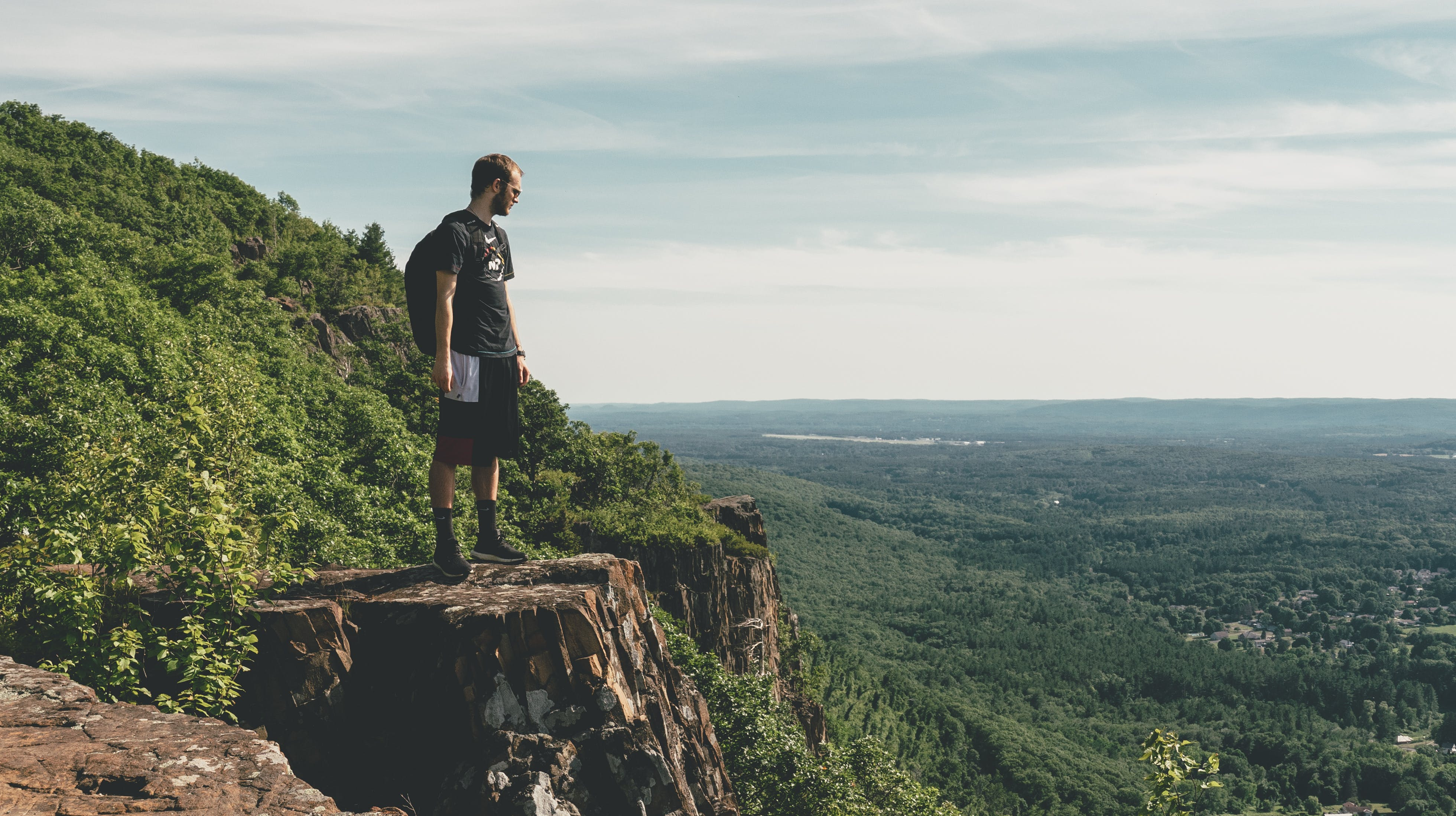 Man Standing On The Cliff