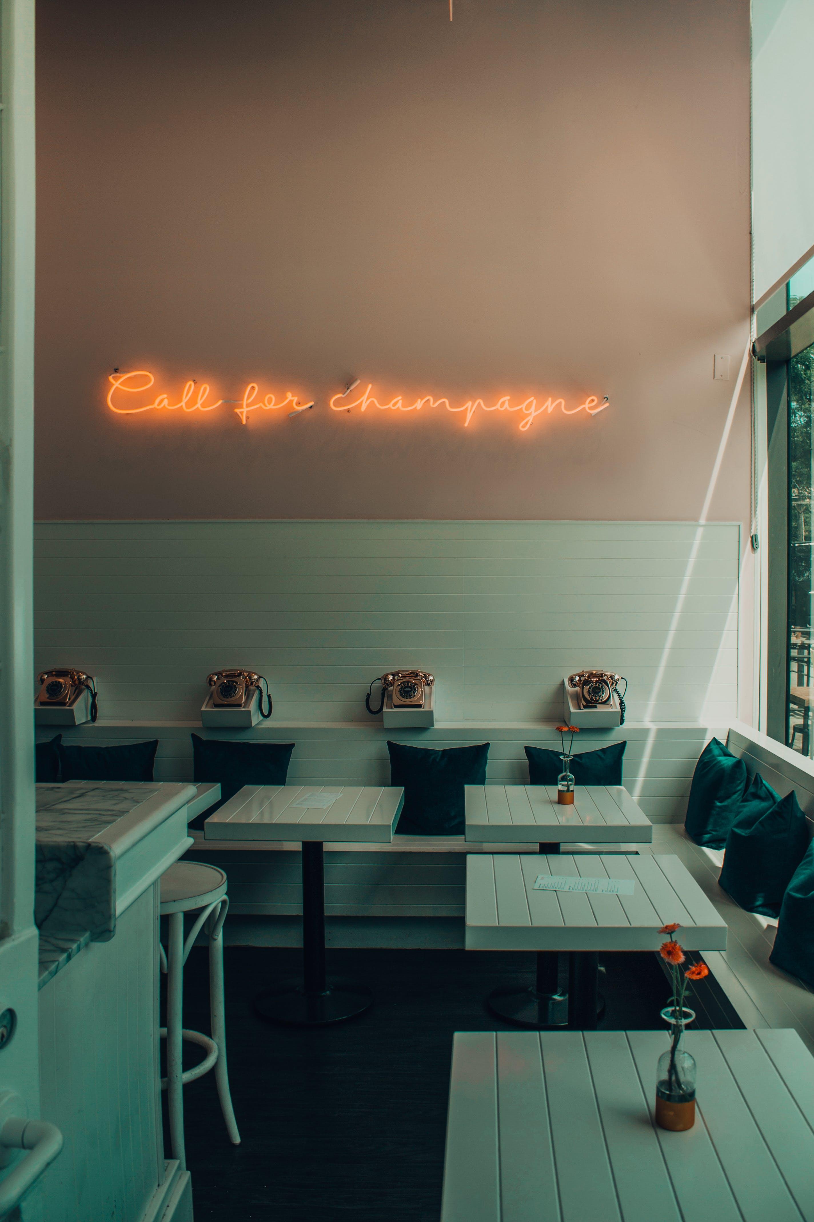 Orange Neon Light Signage On Wall