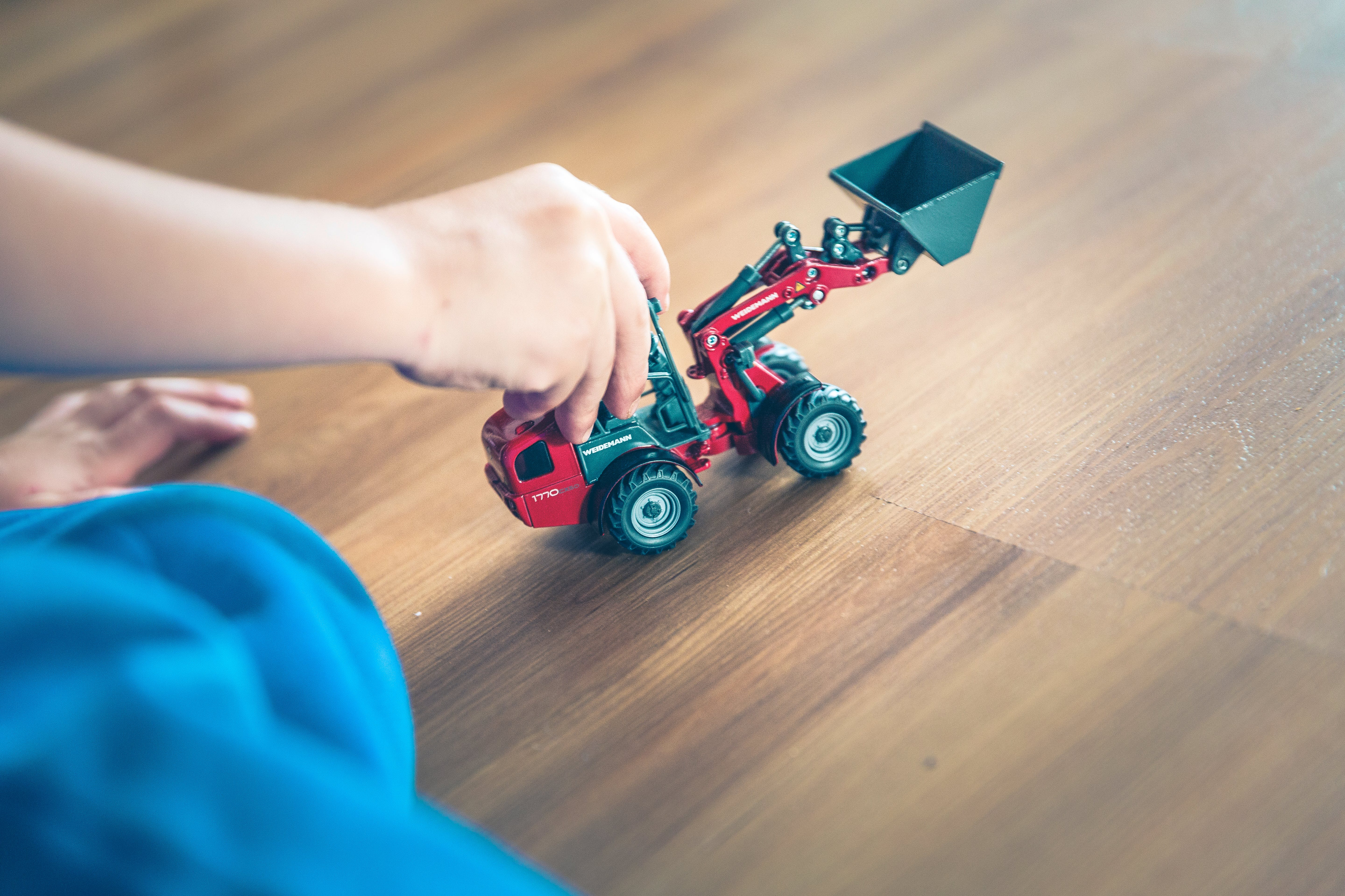 Child Playing Front Loader Toy