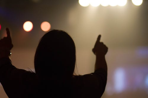 Free stock photo of arms raised, church, concert, jesus