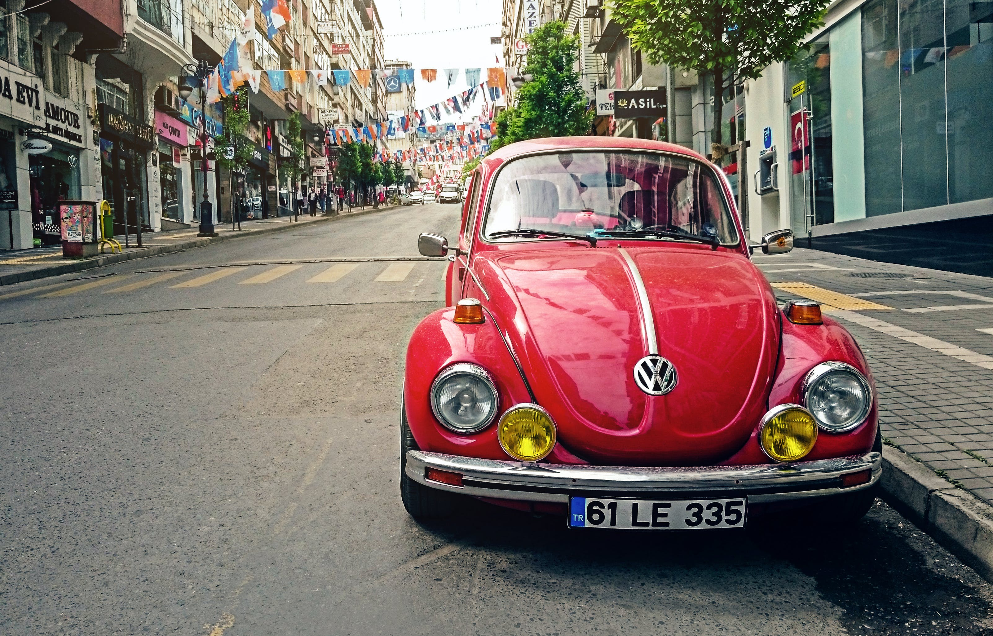 Red Volkswagen Beetle Parked at Road Side Near Pedestrian Lane
