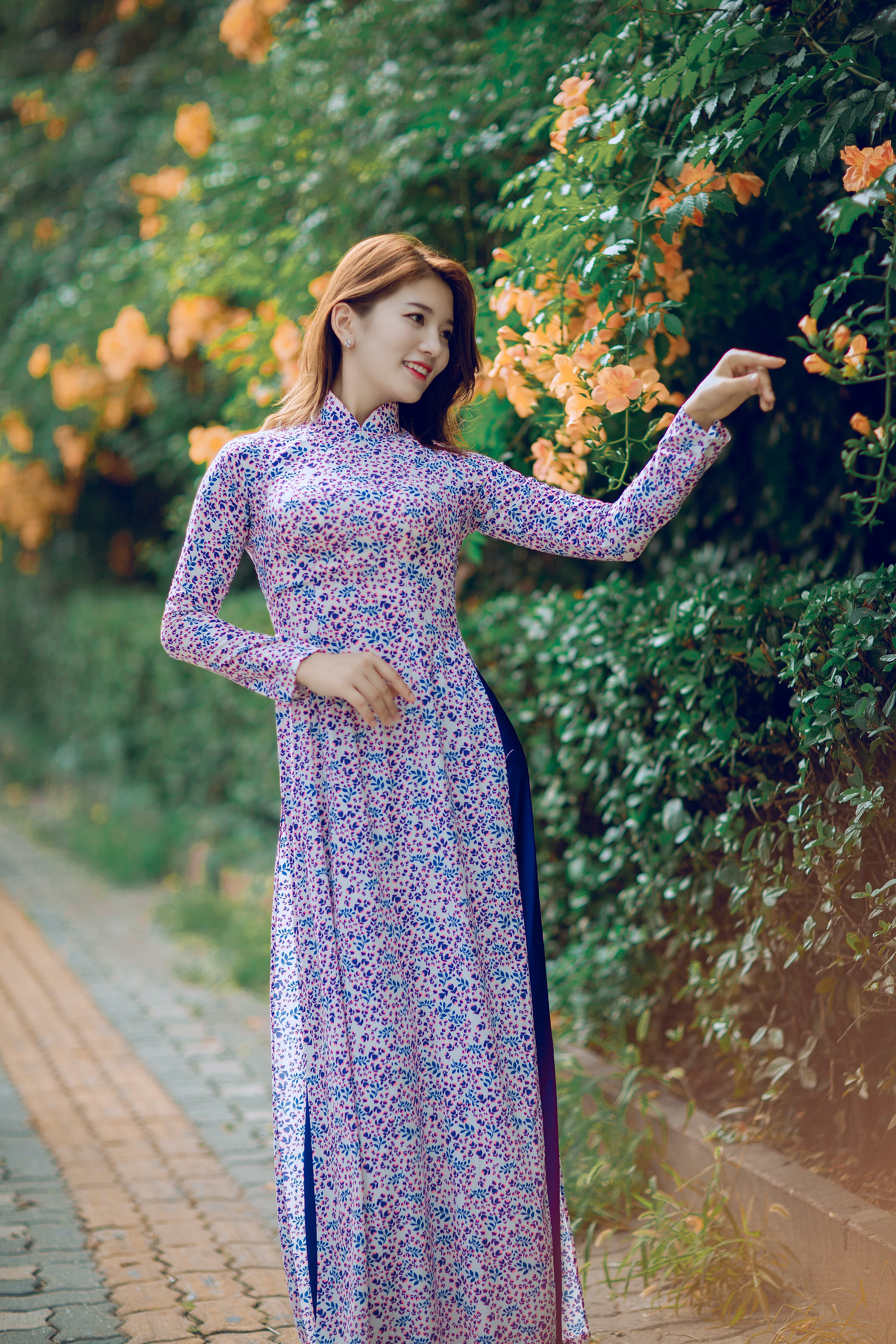 Photography Of Woman In Purple Floral Dress