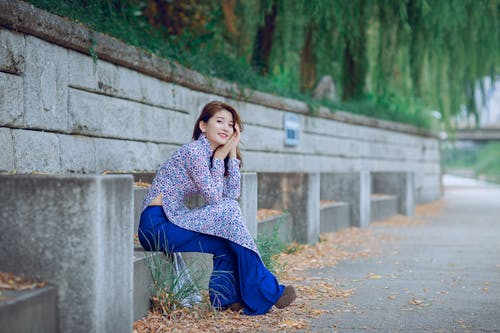 Woman Sitting On Grey Concrete Chair