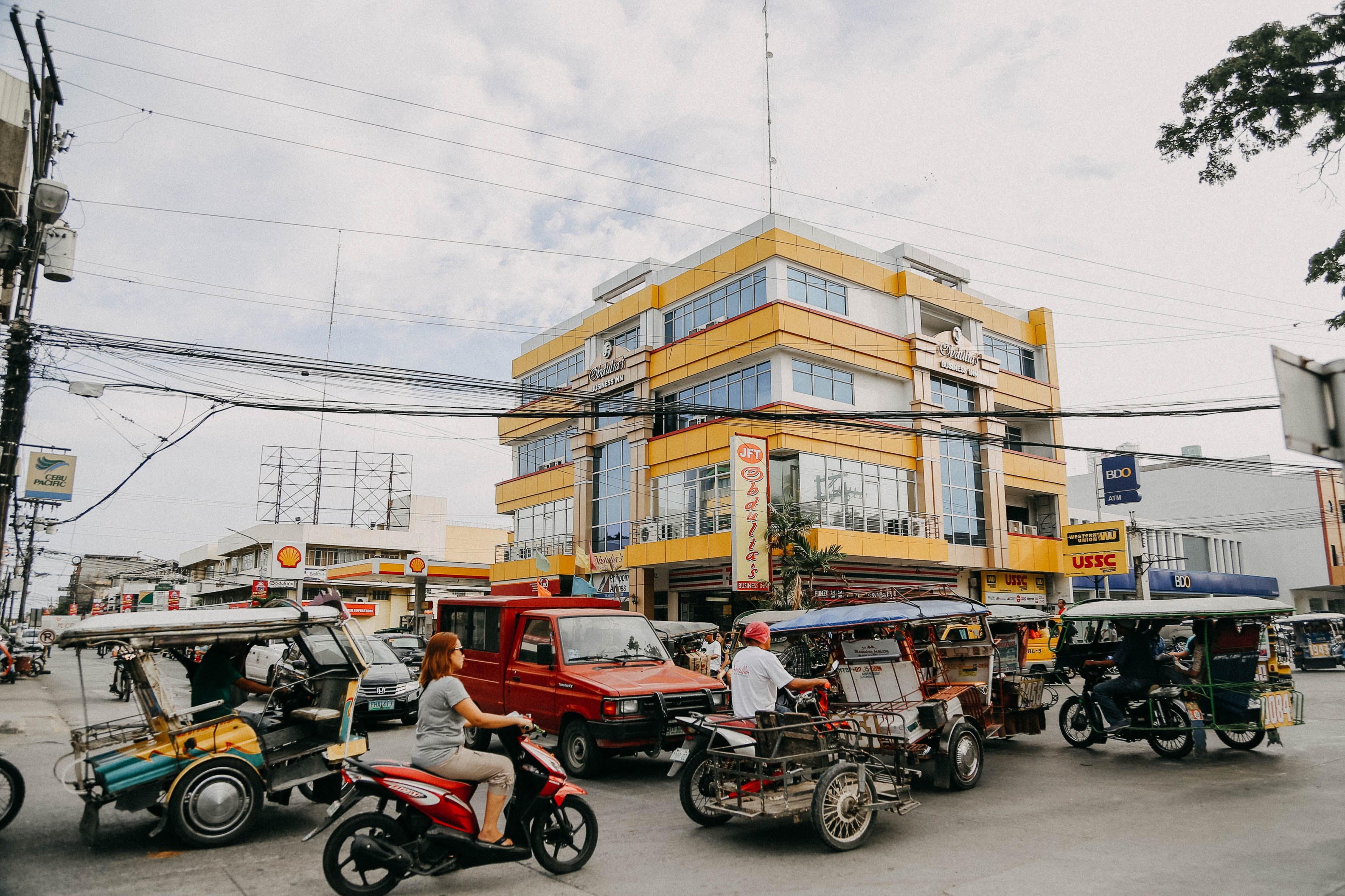 Moving Vehicles Near Yellow Painted Building
