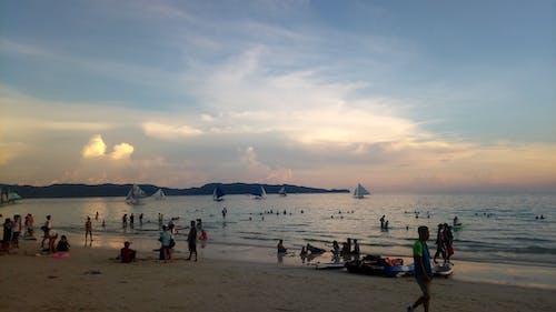 Photos gratuites de coucher de soleil, gens, nuages, plage