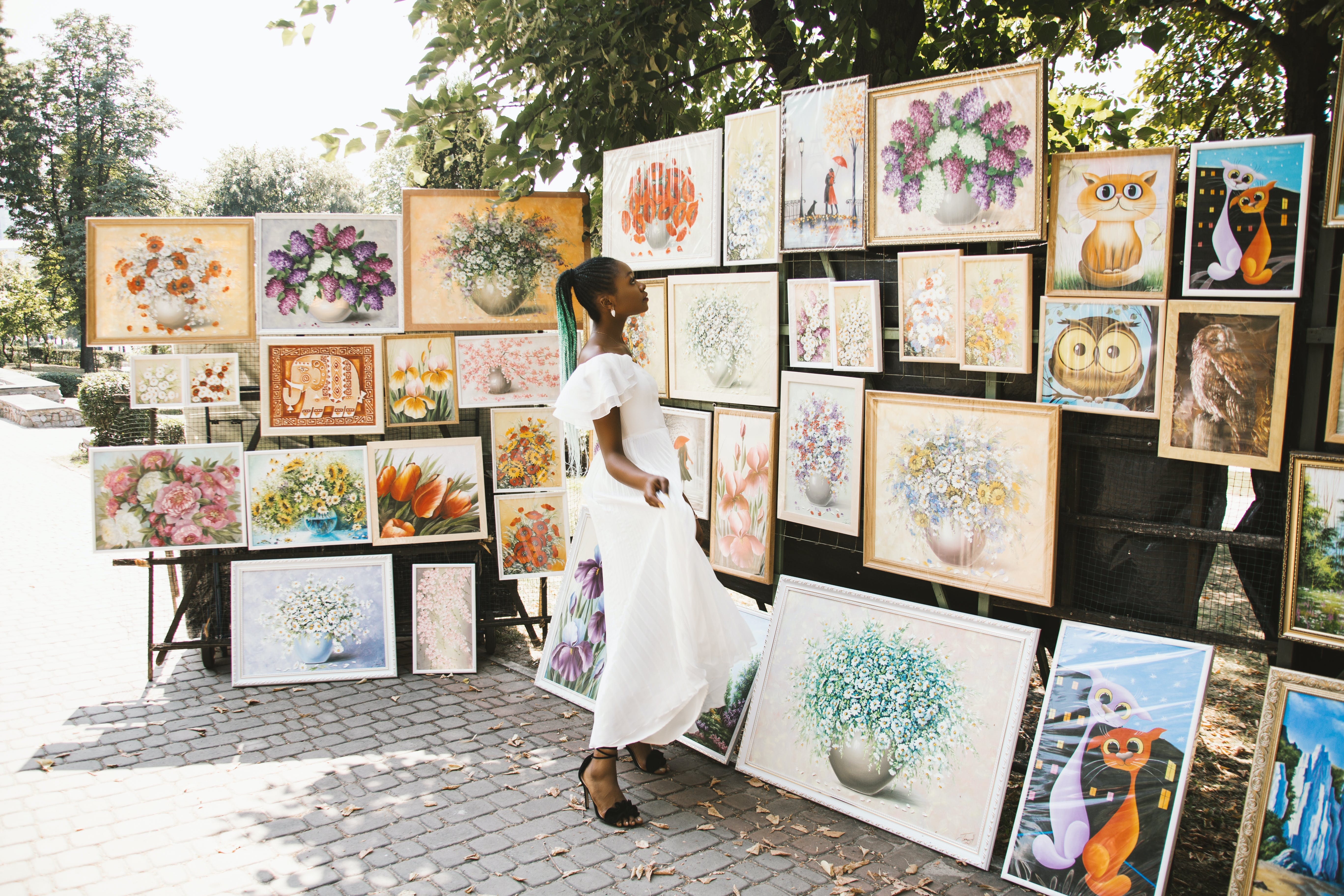 Woman Looking on Flower Painting