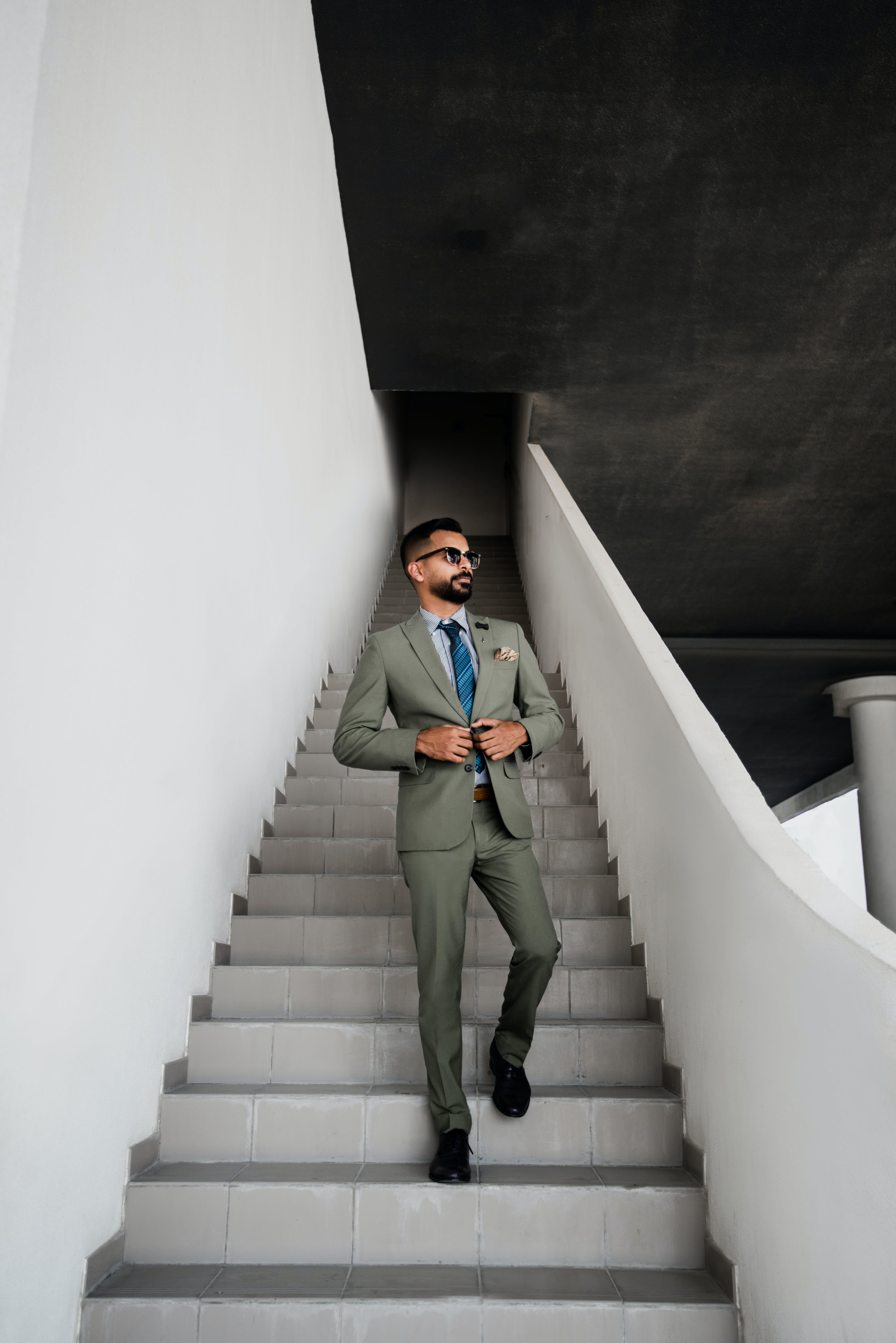 Man In Grey Suit Standing On Stair