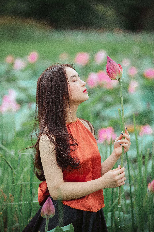 Woman Holding Pink Lotus Flower