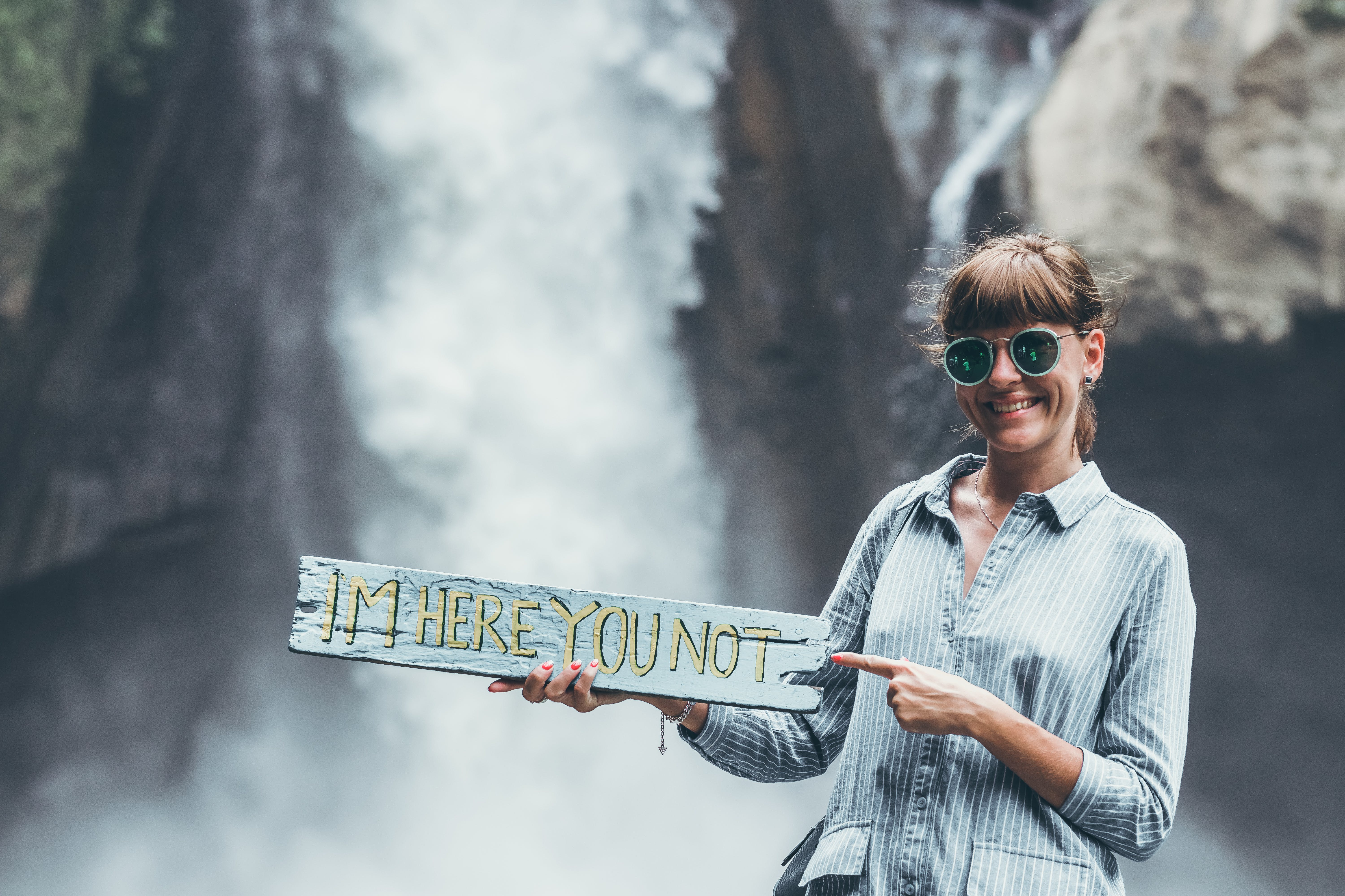 Woman Carrying Im Here You Not Plank on Front of Waterfalls