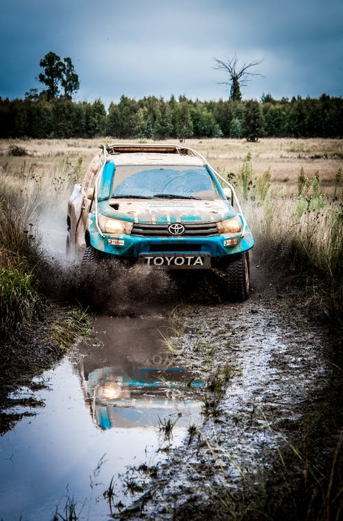 Blue Toyota Car On Dirt Road