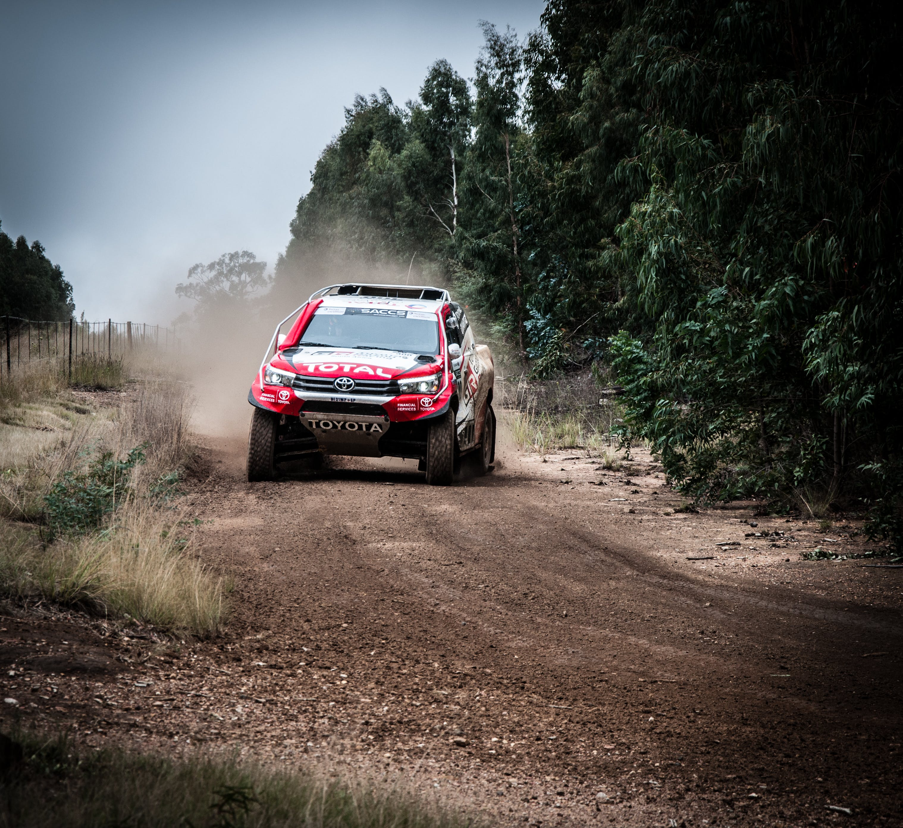 Red Toyota Vehicle On Rough Road