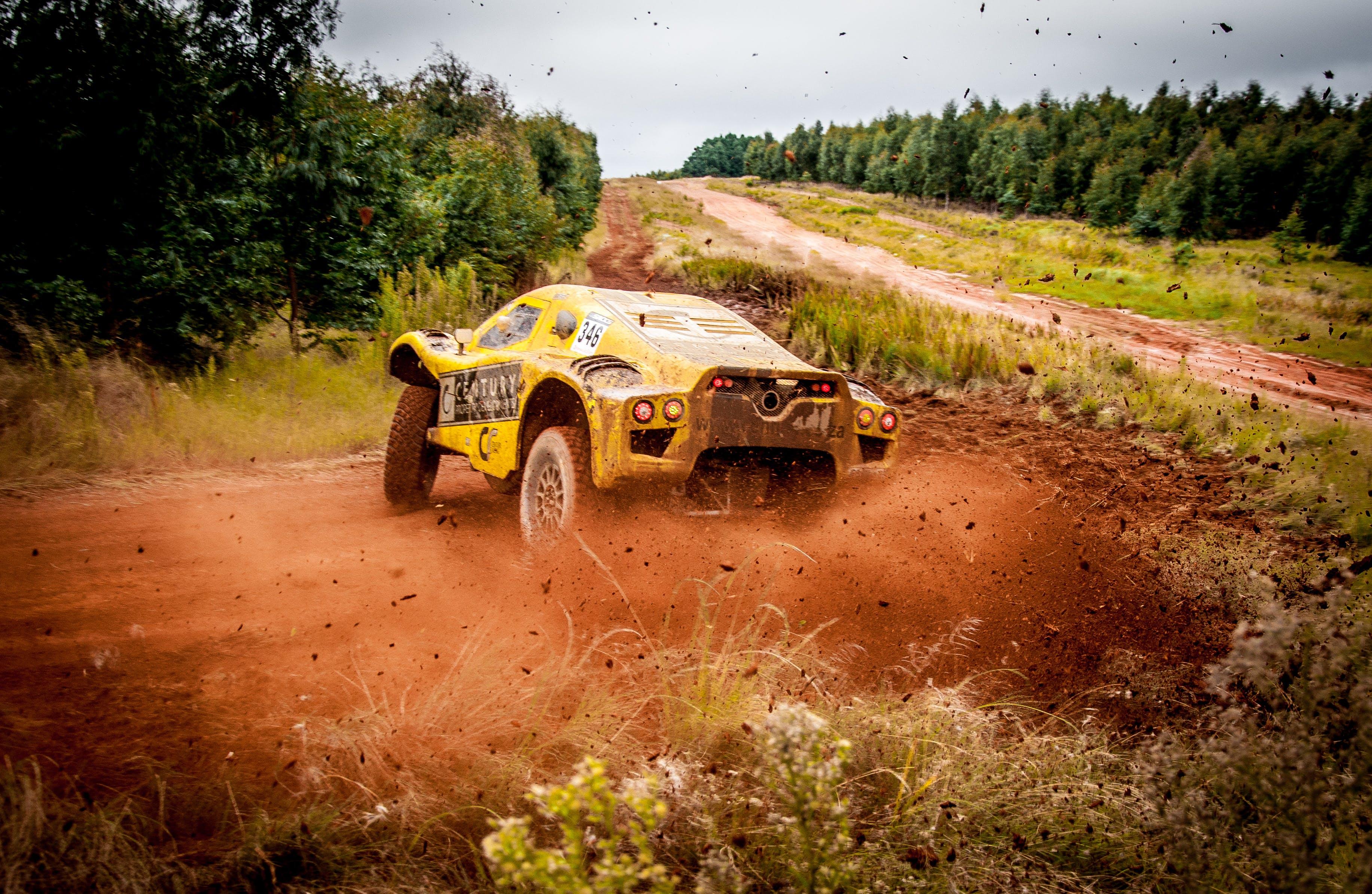 Yellow Car On Mud