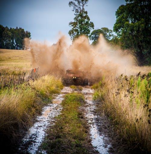 Brown Vehicle On Wet Soil