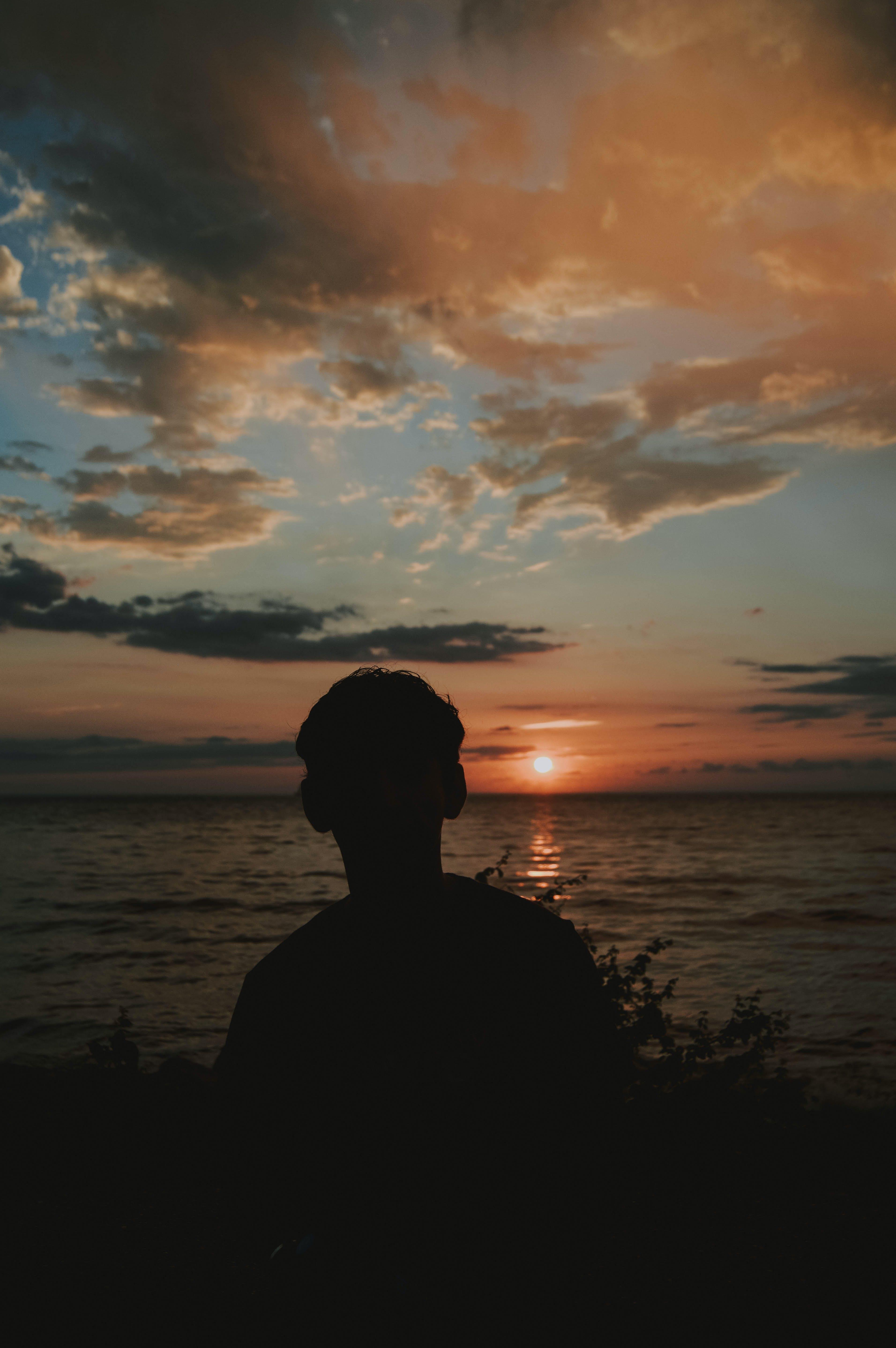 Free stock photo of sea, sunset, man, clouds