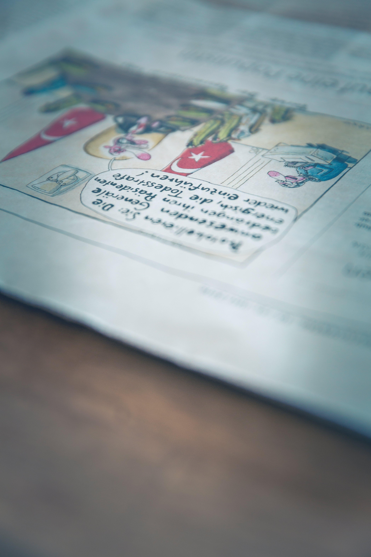 Free stock photo of cartoon, live, news, newspaper