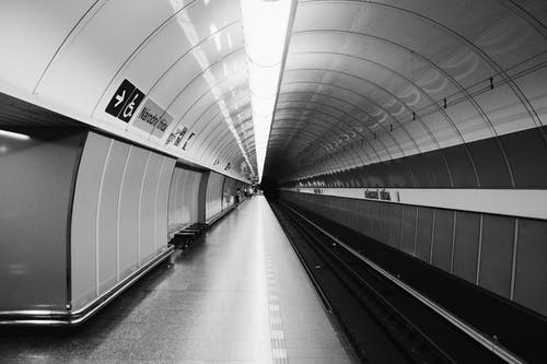 Grayscale Photography Of Subway Station