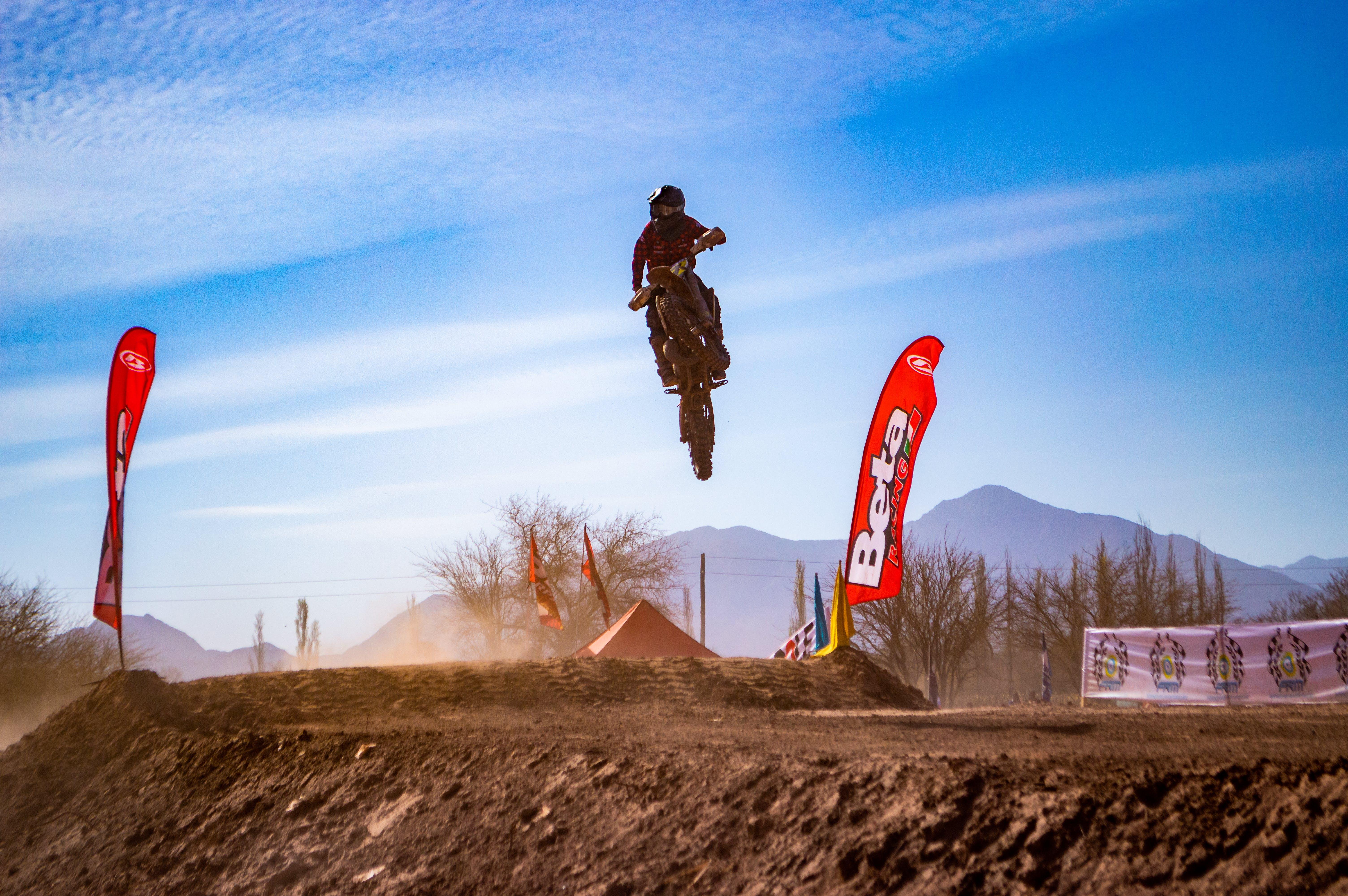 Man Riding Motocross Dirt Bike Doing Stunt