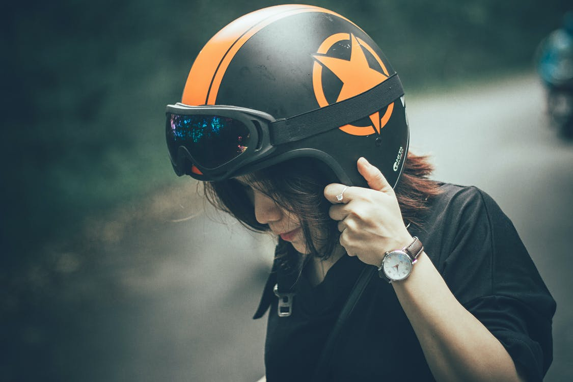 Woman Wearing Black Shirt and Black-and-orange Half-face Helmet