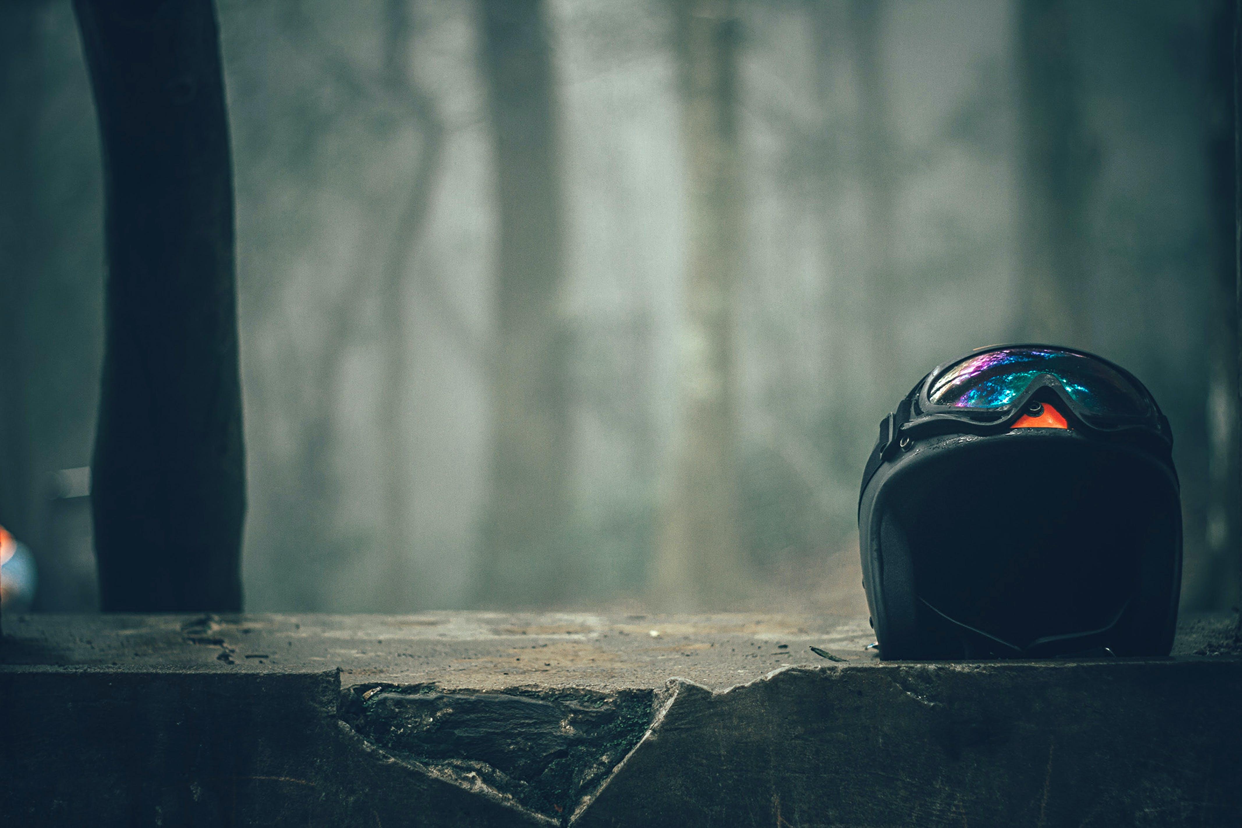 Black Half-faced Helmet on Gray Concrete Wall
