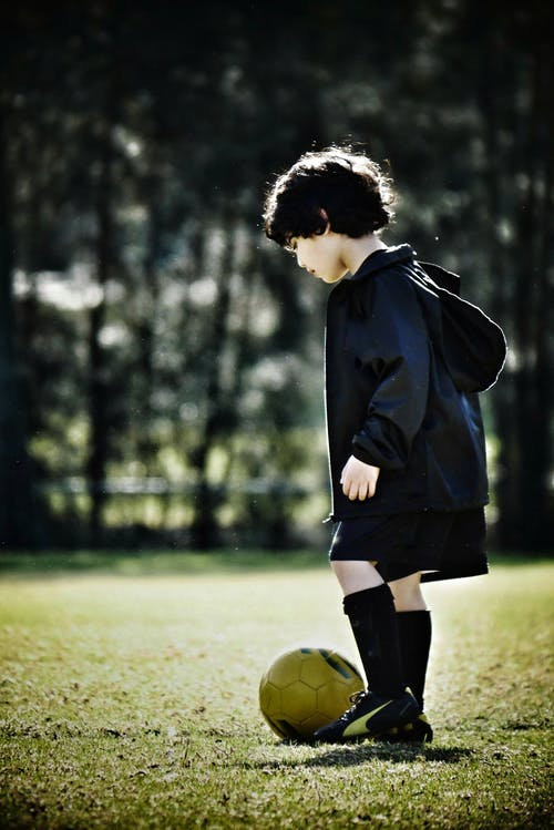 Free stock photo of football player, kid, soccer