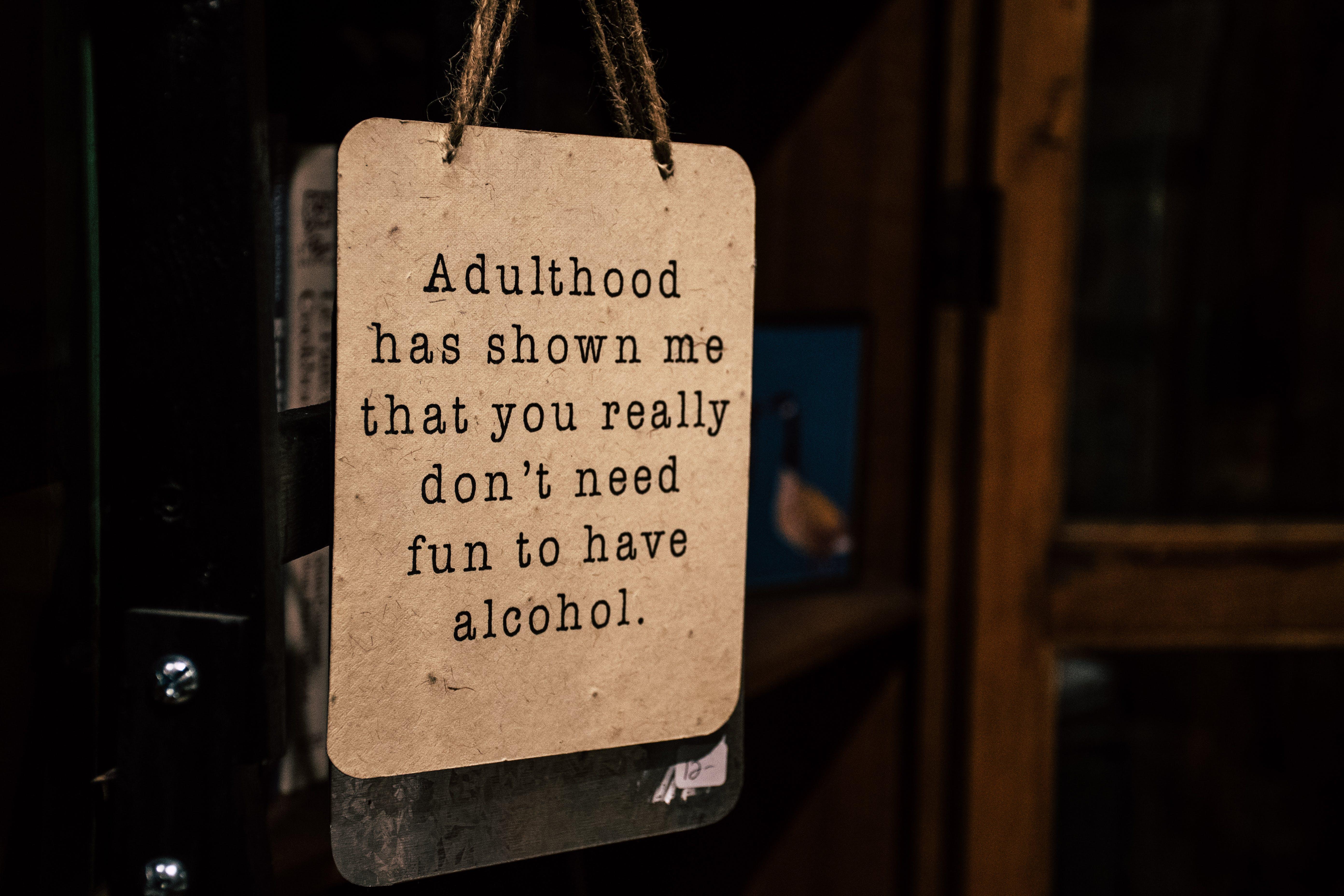 Brown Wooden Signage Hanged on Door