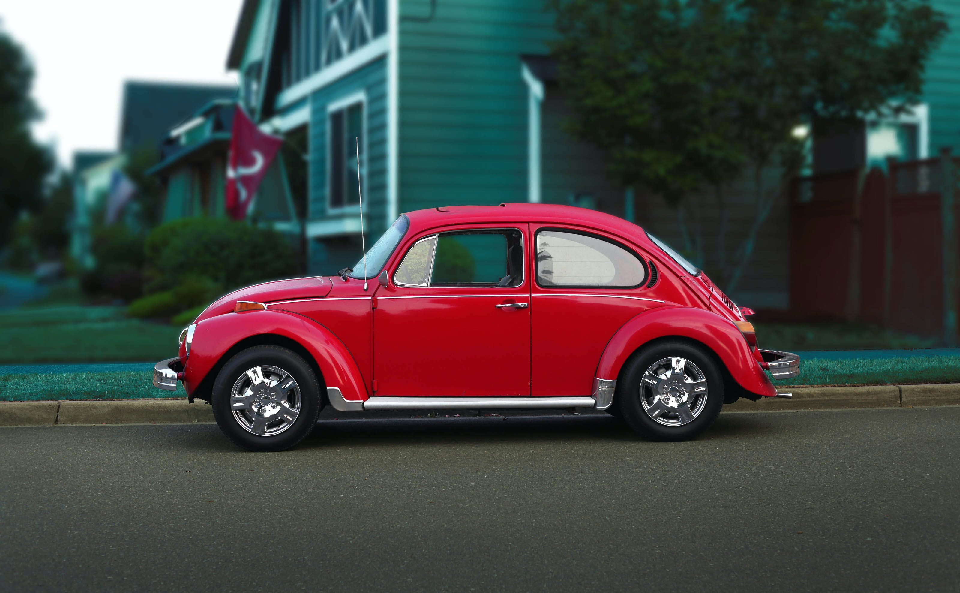 Red Volkswagen Beetle On Road